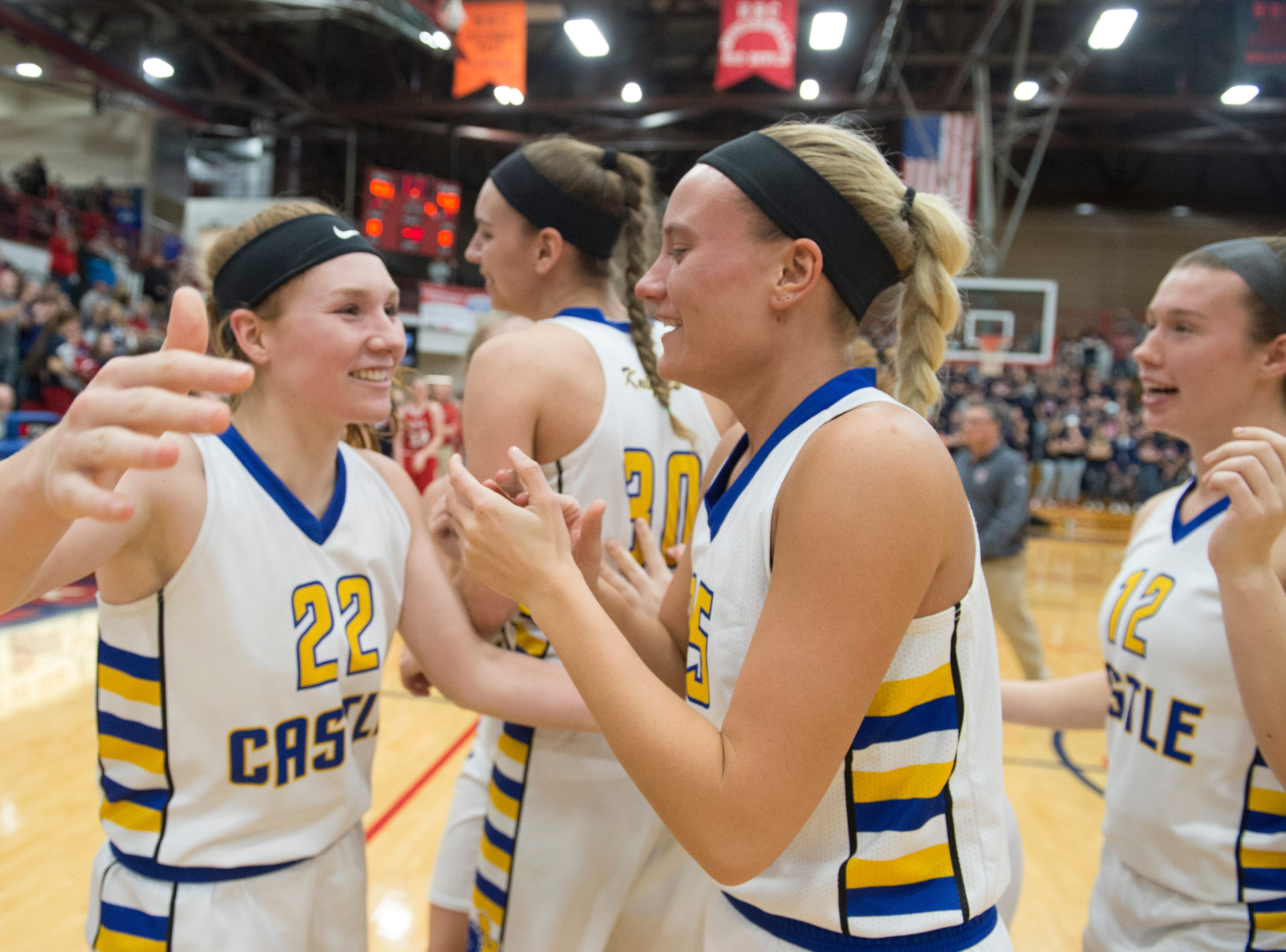 Castle's Hannah Hood (22) hugs Paige Hopkins (25) as they celebrate their IIHSAA Girls Basketball Class 4A Regional Championship game win over the Bedford North Lawrence Lady Stars at the Stars Field House in Bedford, Ind. Saturday, Feb. 9, 2019.