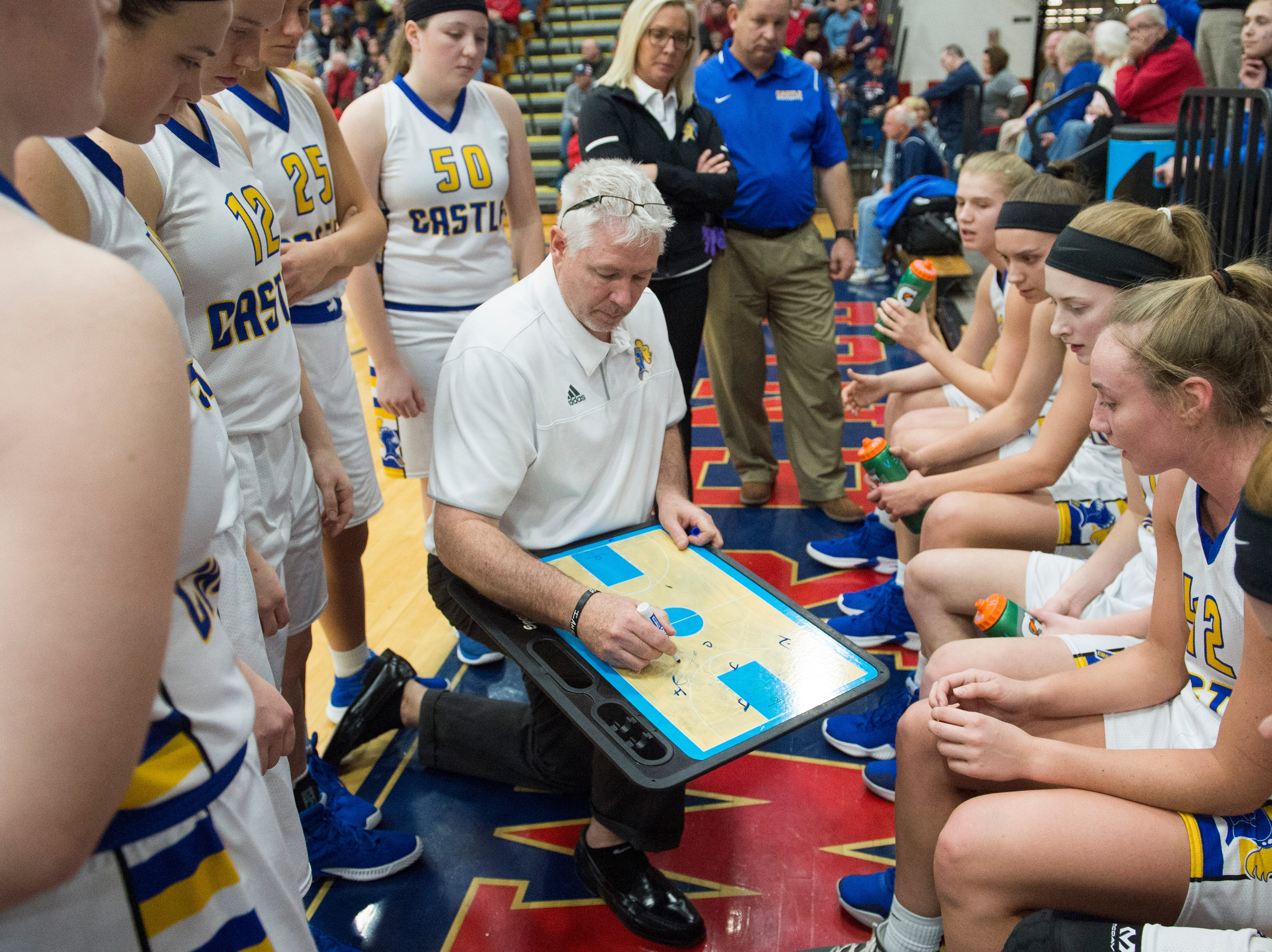 Castle Head Coach Robert Meier gives direction during a timeout in the  IHSAA Girls Basketball Class 4A Regional Championship game against the Bedford North Lawrence Lady Stars at the Stars Field House in Bedford, Ind. Saturday, Feb. 9, 2019.