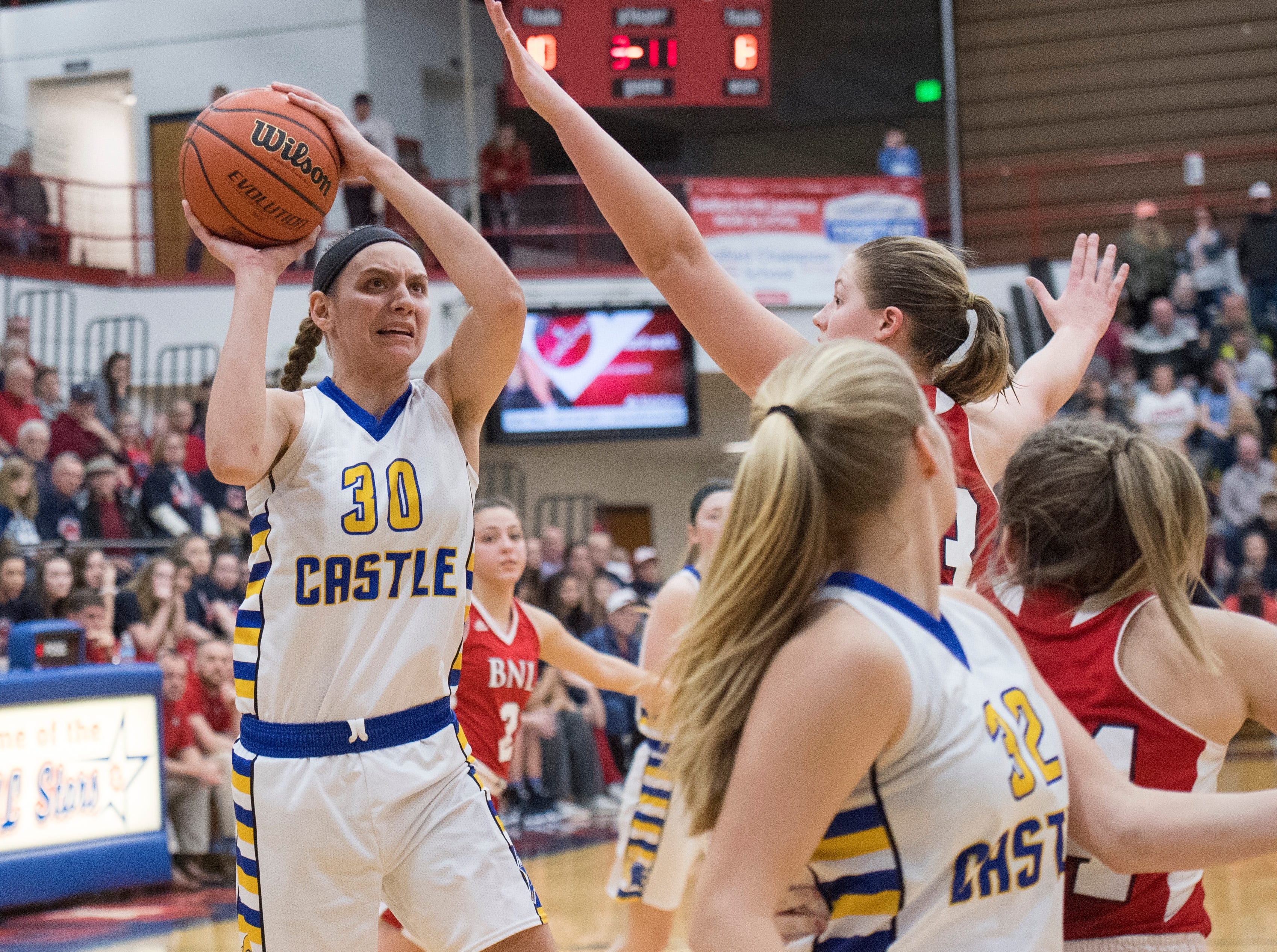 Castle's Jessica Nunge (30) takes a shot IHSAA Girls Basketball Class 4A Regional Championship game against the Bedford North Lawrence Lady Stars at the Stars Field House in Bedford, Ind. Saturday, Feb. 9, 2019.
