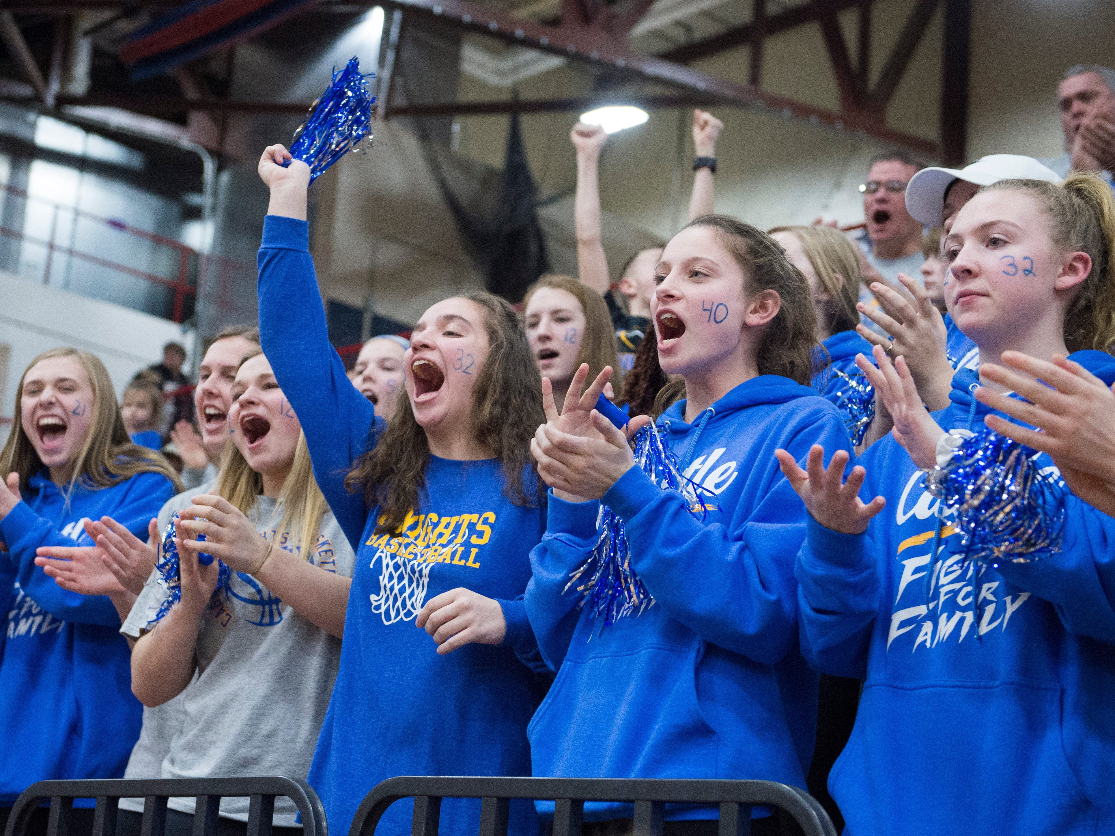 The Castle JV basketball team cheers on the varsity team as they take on the Bedford North Lawrence Lady Stars during the  IHSAA Girls Basketball Class 4A Regional Championship game at the Stars Field House in Bedford, Ind. Saturday, Feb. 9, 2019.