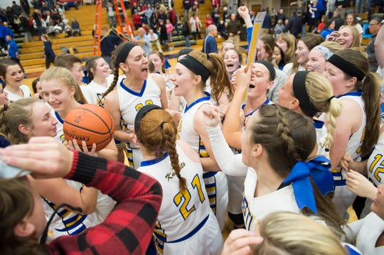 The Castle Lady Knights celebrate with peers after winning IHSAA Girls Basketball Class 4A Regional championship game against the Bedford North Lawrence Lady Stars Saturday, Feb. 9, 2019. The Lady Knights won 54-48.