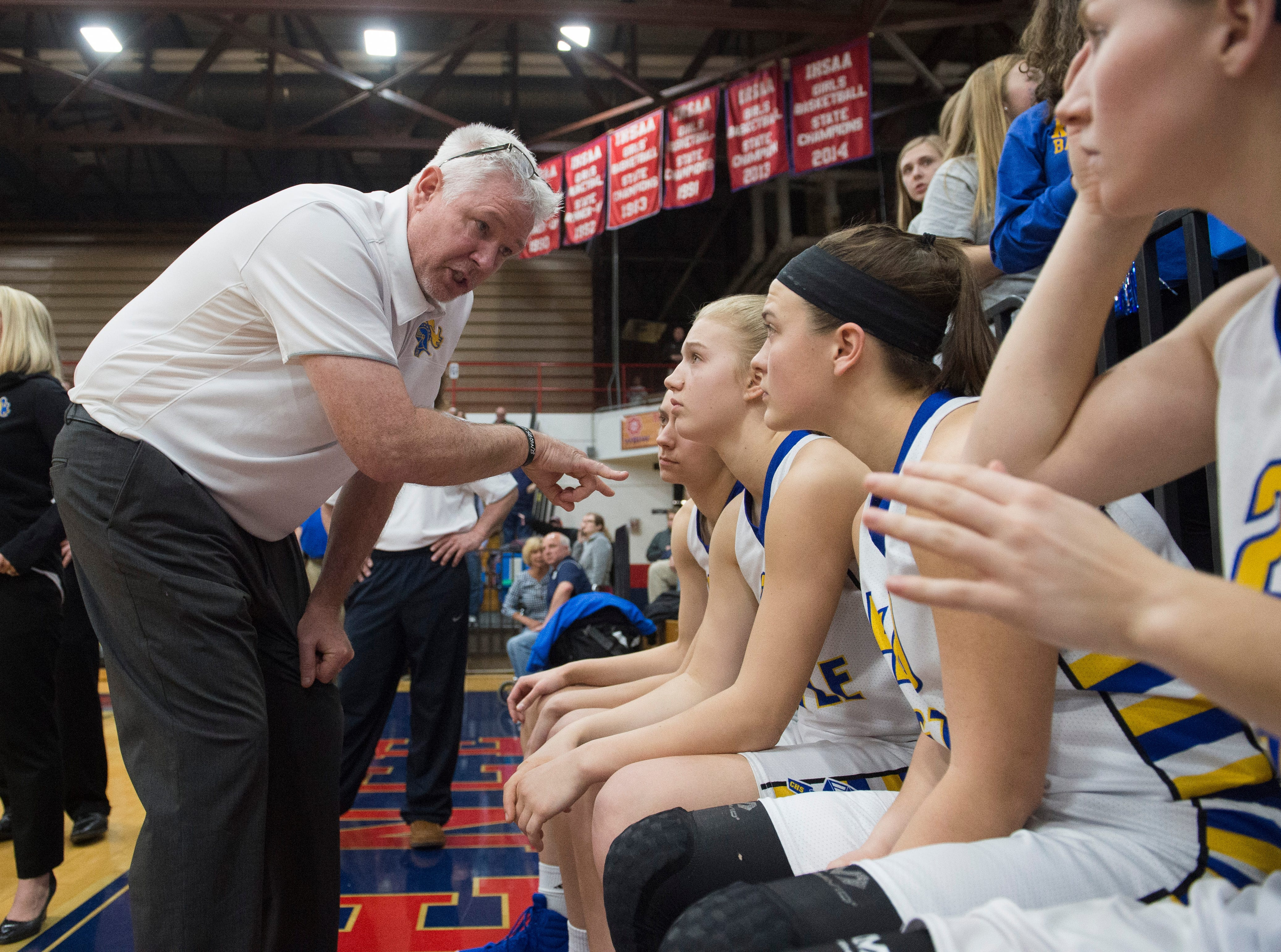 Castle Head Coach Robert Meier instructs the girls basketball team before the IHSAA Girls Basketball Class 4A Regional Championship game against the Bedford North Lawrence Lady Stars at the Stars Field House in Bedford, Ind. Saturday, Feb. 9, 2019.