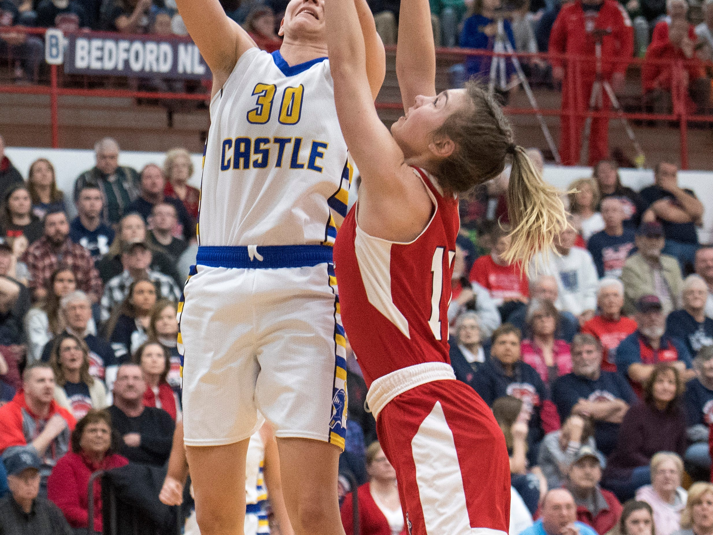 Castle's Jessica Nunge (30) takes a shot during the  IHSAA Girls Basketball Class 4A Regional Championship game against the Bedford North Lawrence Lady Stars at the Stars Field House in Bedford, Ind. Saturday, Feb. 9, 2019.