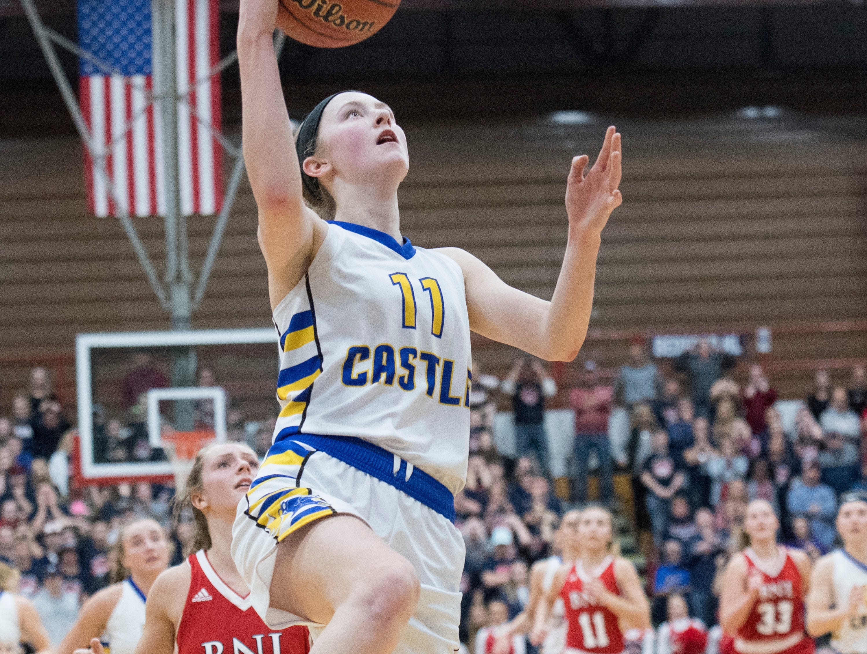 Castle's Carly Harpenau (11) takes a shot during the IHSAA Girls Basketball Class 4A Regional Championship game against the Bedford North Lawrence Lady Stars at the Stars Field House in Bedford, Ind. Saturday, Feb. 9, 2019.