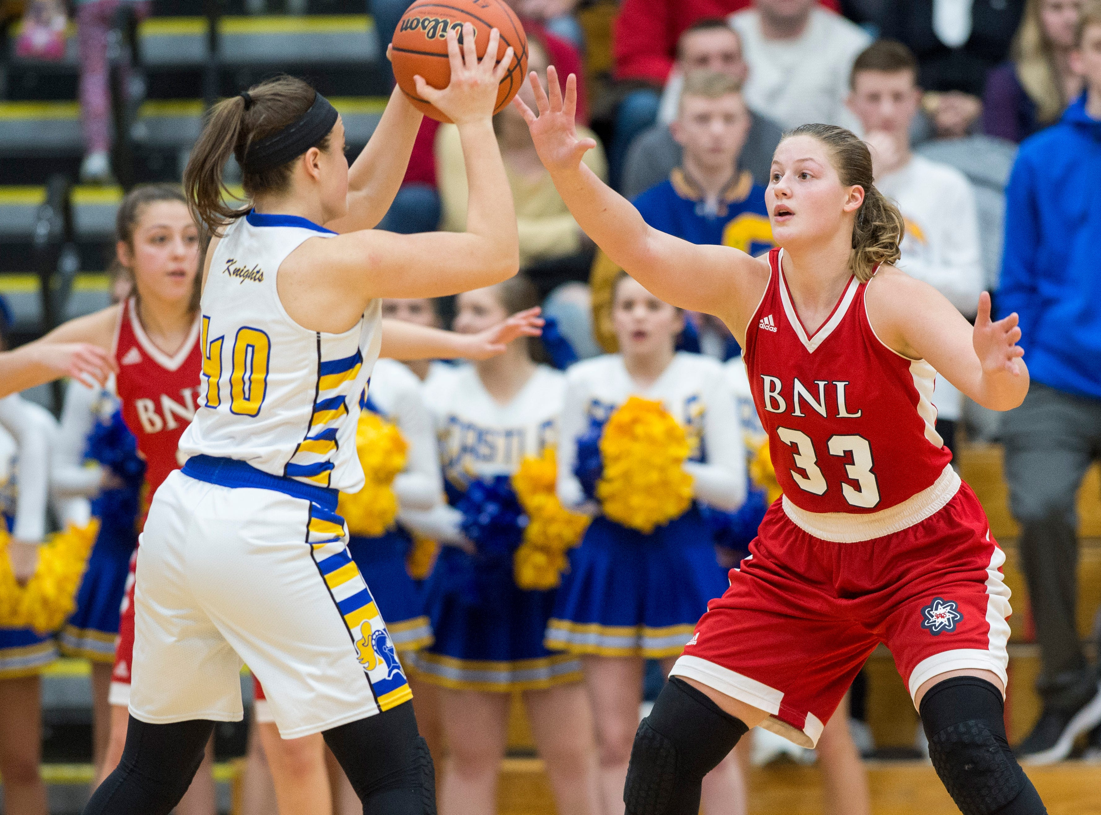 Bedford North Lawrence's Jorie Allen (33) guards Castle's Mckenna Tutt (40) during the IHSAA Girls Basketball Class 4A Regional Championship game against the Castle Knights at the Stars Field House in Bedford, Ind. Saturday, Feb. 9, 2019.