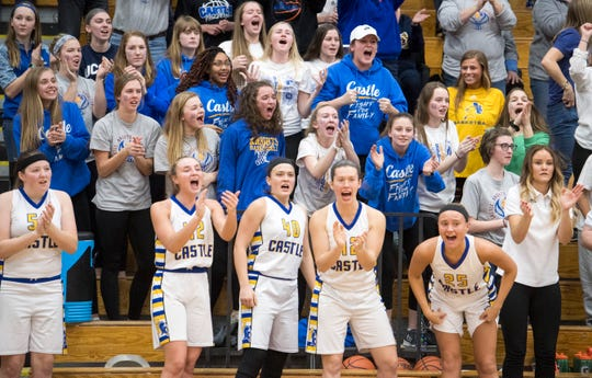 The bench and fans erupt as castle holds the lead after a free thrown during the IHSAA Girls Basketball Class 4A Regional Championship game against the Bedford North Lawrence Lady Stars at the Stars Field House in Bedford, Ind. Saturday, Feb. 9, 2019.