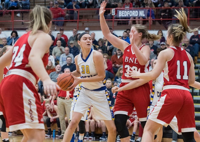 Castle's Jessica Nunge (30) looks to get around Bedford North Lawrence defense during the IHSAA Girls Basketball Class 4A Regional Championship game against the Bedford North Lawrence Lady Stars at the Stars Field House in Bedford, Ind. Saturday, Feb. 9, 2019.