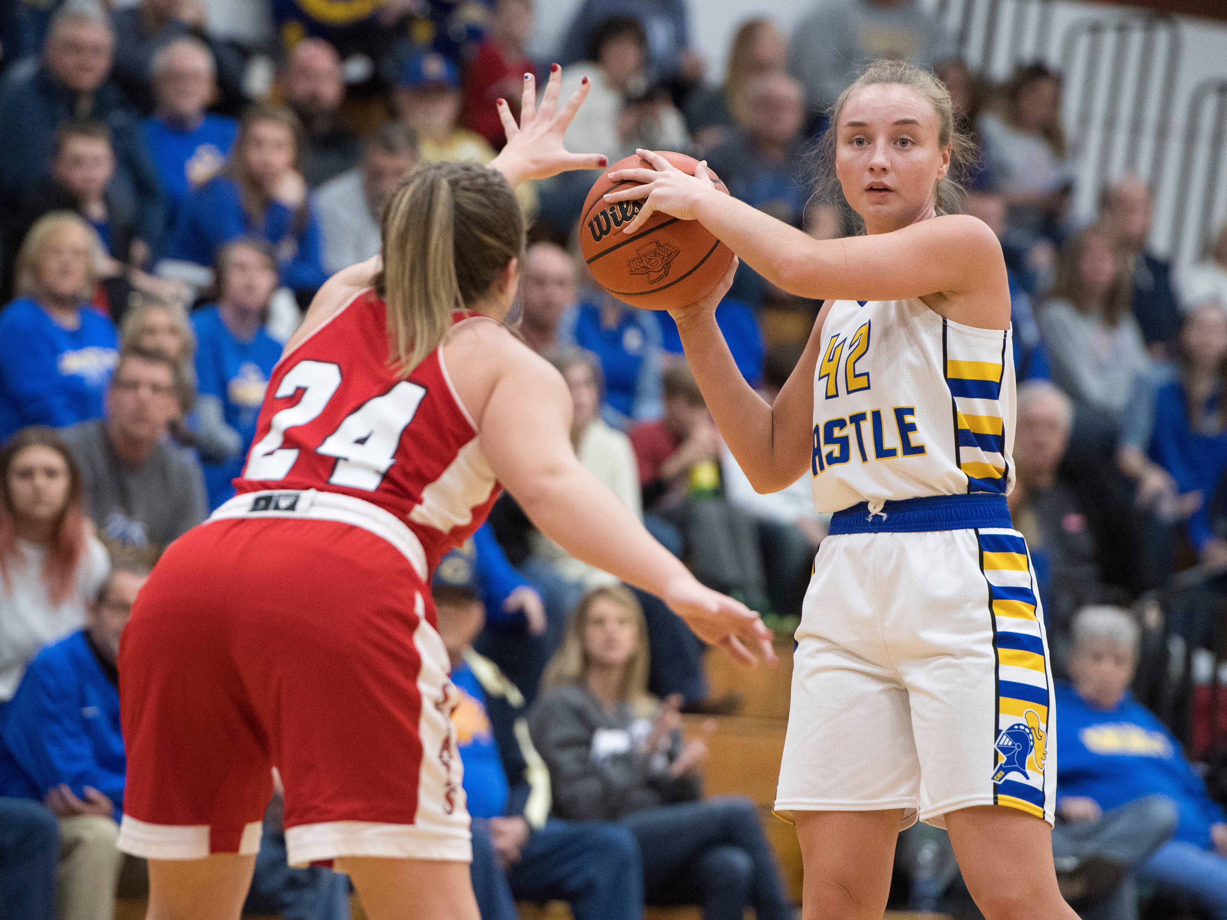Castle's Josie Freeman (42) passes the ball during the  IHSAA Girls Basketball Class 4A Regional Championship game against the Bedford North Lawrence Lady Stars at the Stars Field House in Bedford, Ind. Saturday, Feb. 9, 2019.