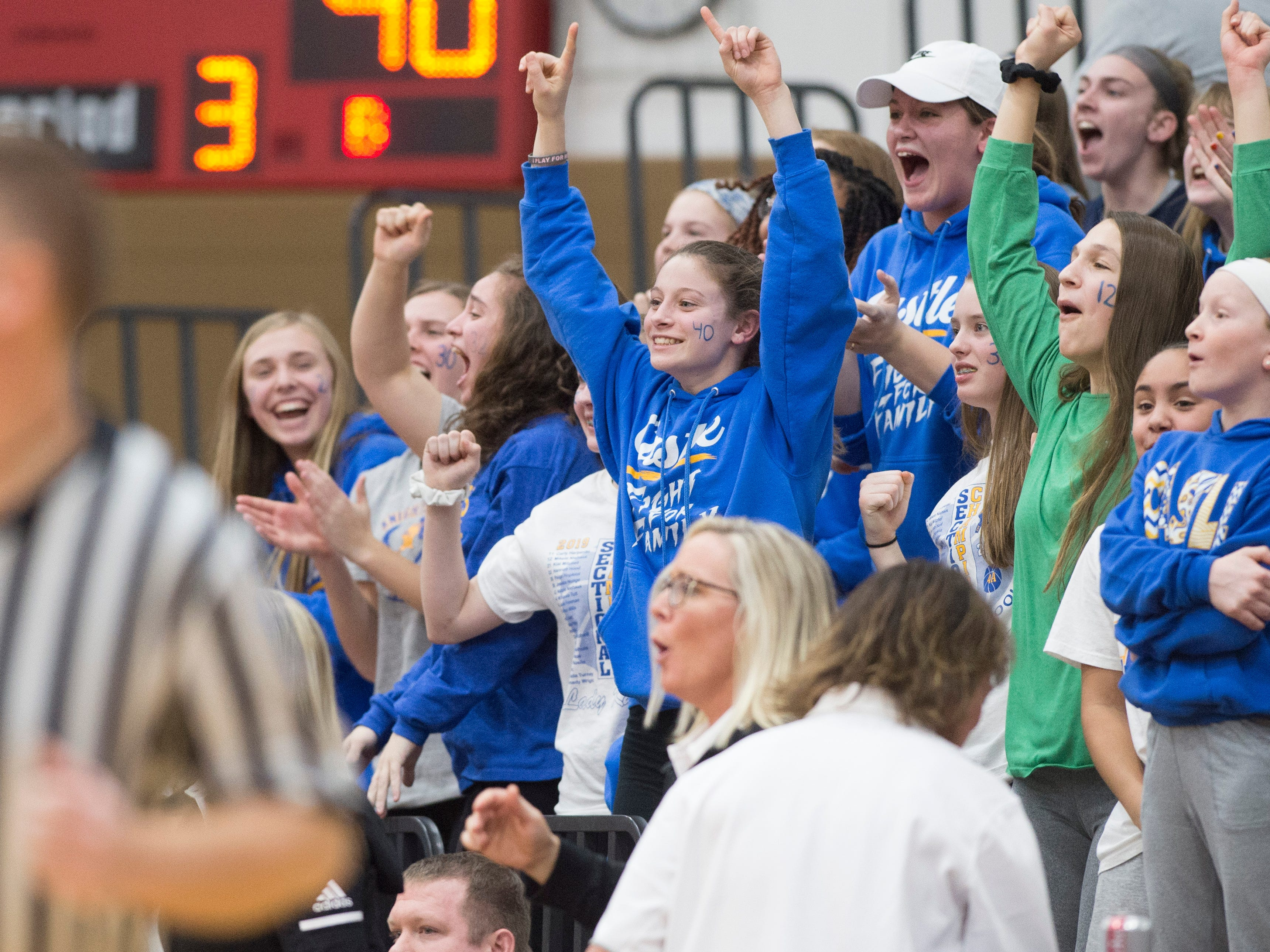 The Castle Knights JV girls baksetball team cheer on their fellows Knights during the IHSAA Girls Basketball Class 4A Regional Championship game against the Bedford North Lawrence Lady Stars at the Stars Field House in Bedford, Ind. Saturday, Feb. 9, 2019.