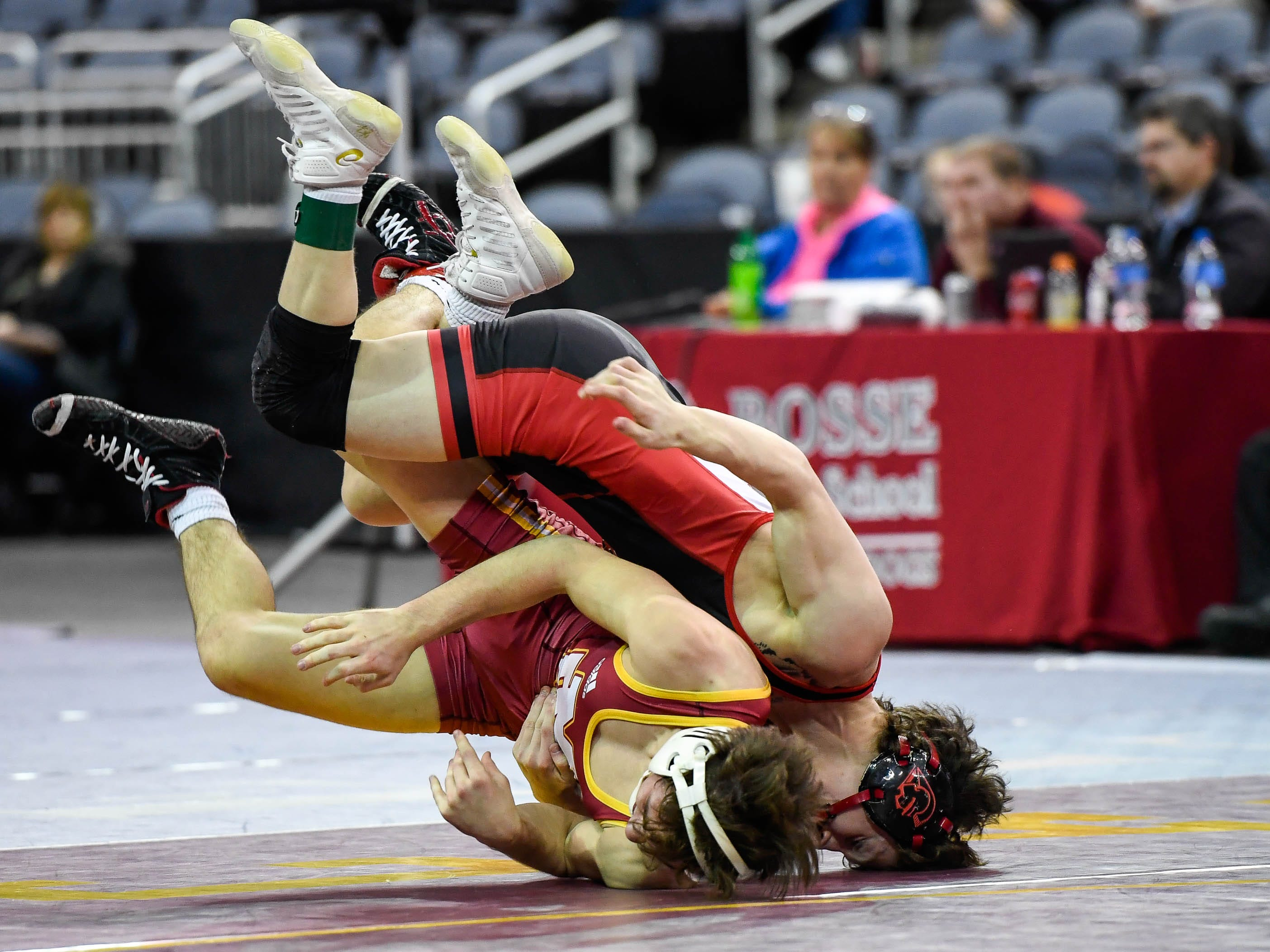 Blake Boarman, Evansville Mater Dei, wrestles Brayden Littell, Center Grove, in the 120 weight class at the Indiana High School Athletic Association Semi-State Wrestling Tournament held at the Ford Center Saturday, February 9, 2019.