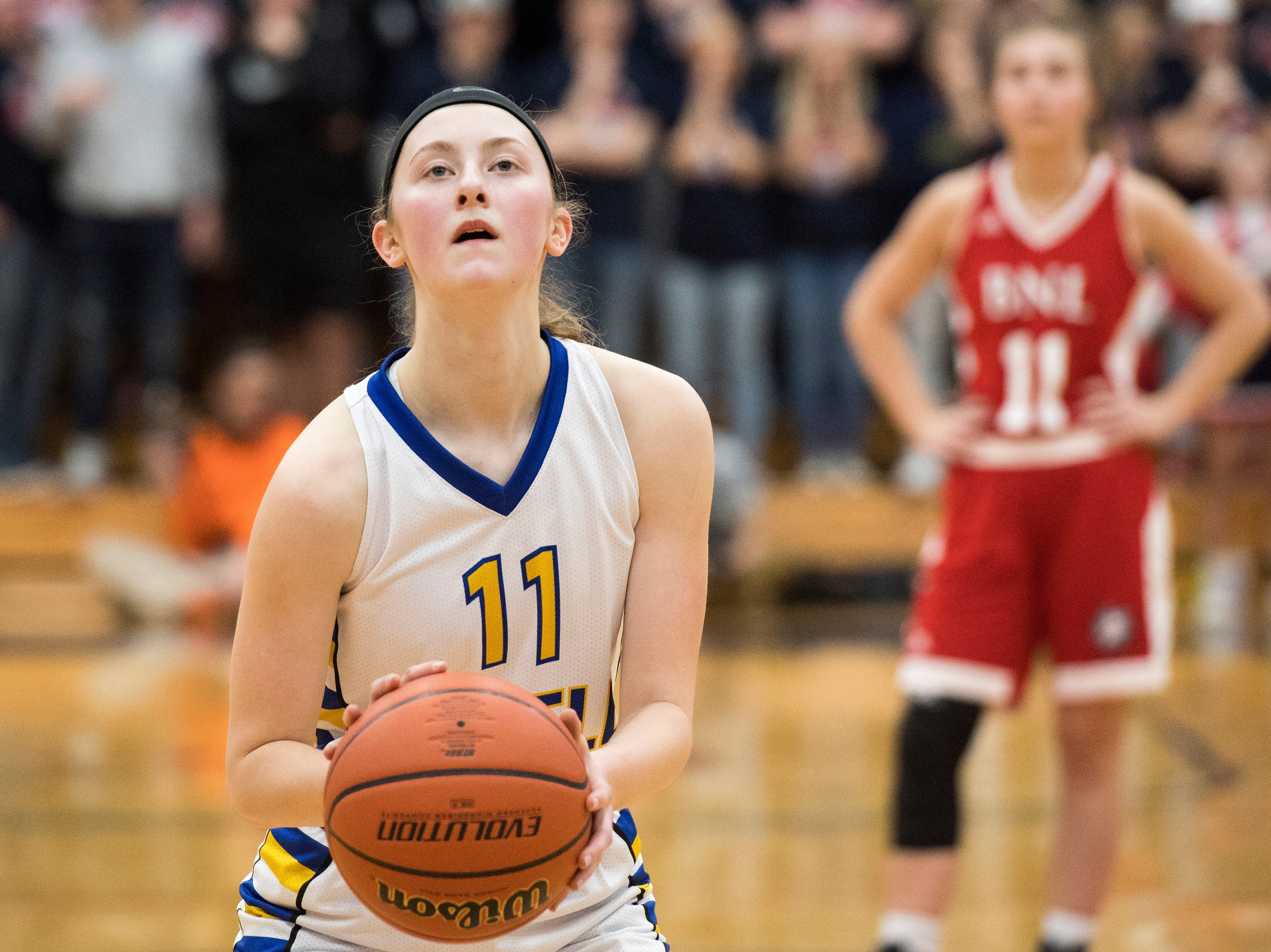 Castle's Carly Harpenau (11) takes a free throw shot during the IHSAA Girls Basketball Class 4A Regional Championship game against the Bedford North Lawrence Lady Stars at the Stars Field House in Bedford, Ind. Saturday, Feb. 9, 2019.