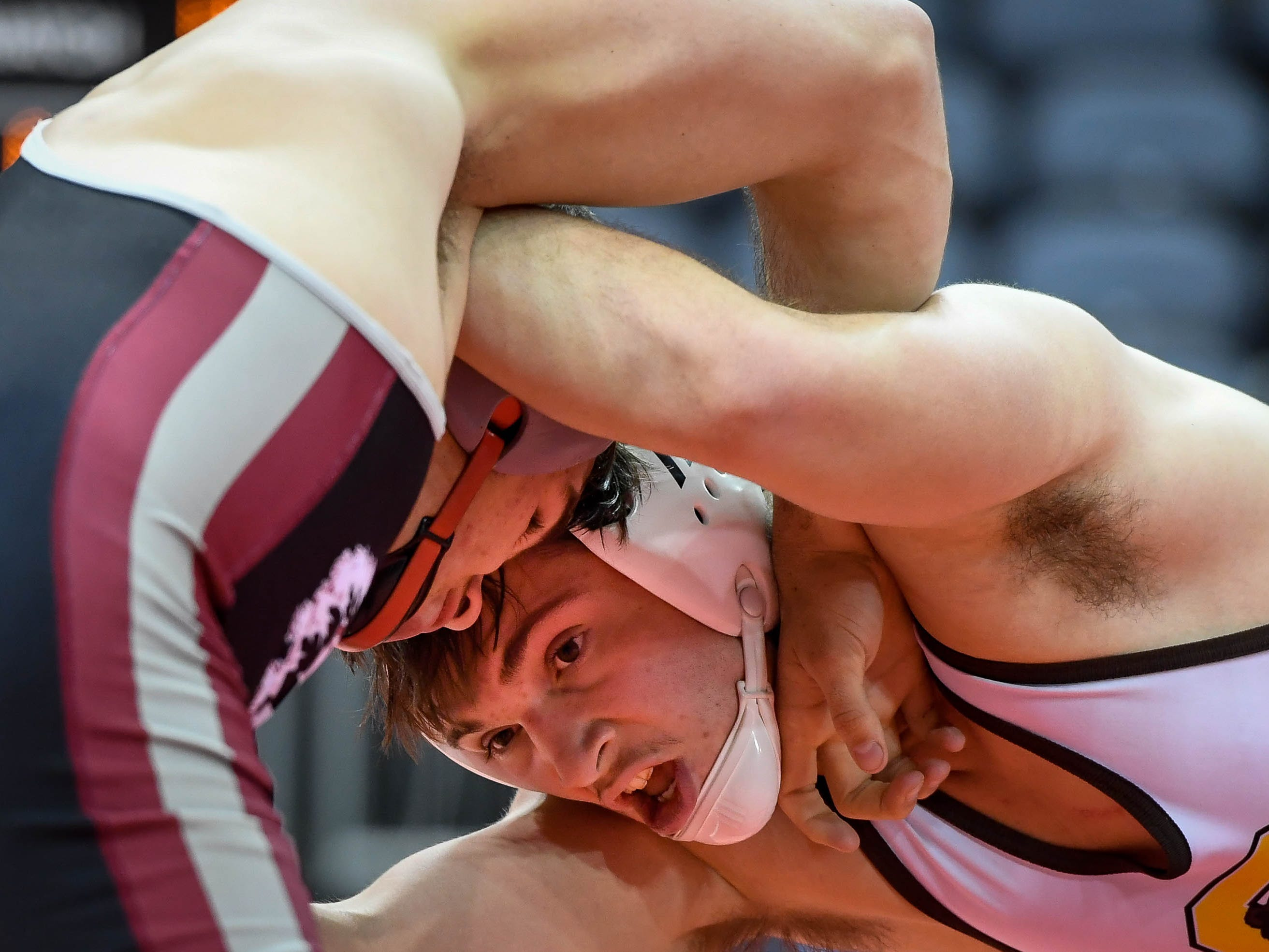 McKinley Kemper, Evansville Central, wrestles Tizton Carson in the 182 weight class, at the Indiana High School Athletic Association Semi-State Wrestling Tournament held at the Ford Center Saturday, February 9, 2019.