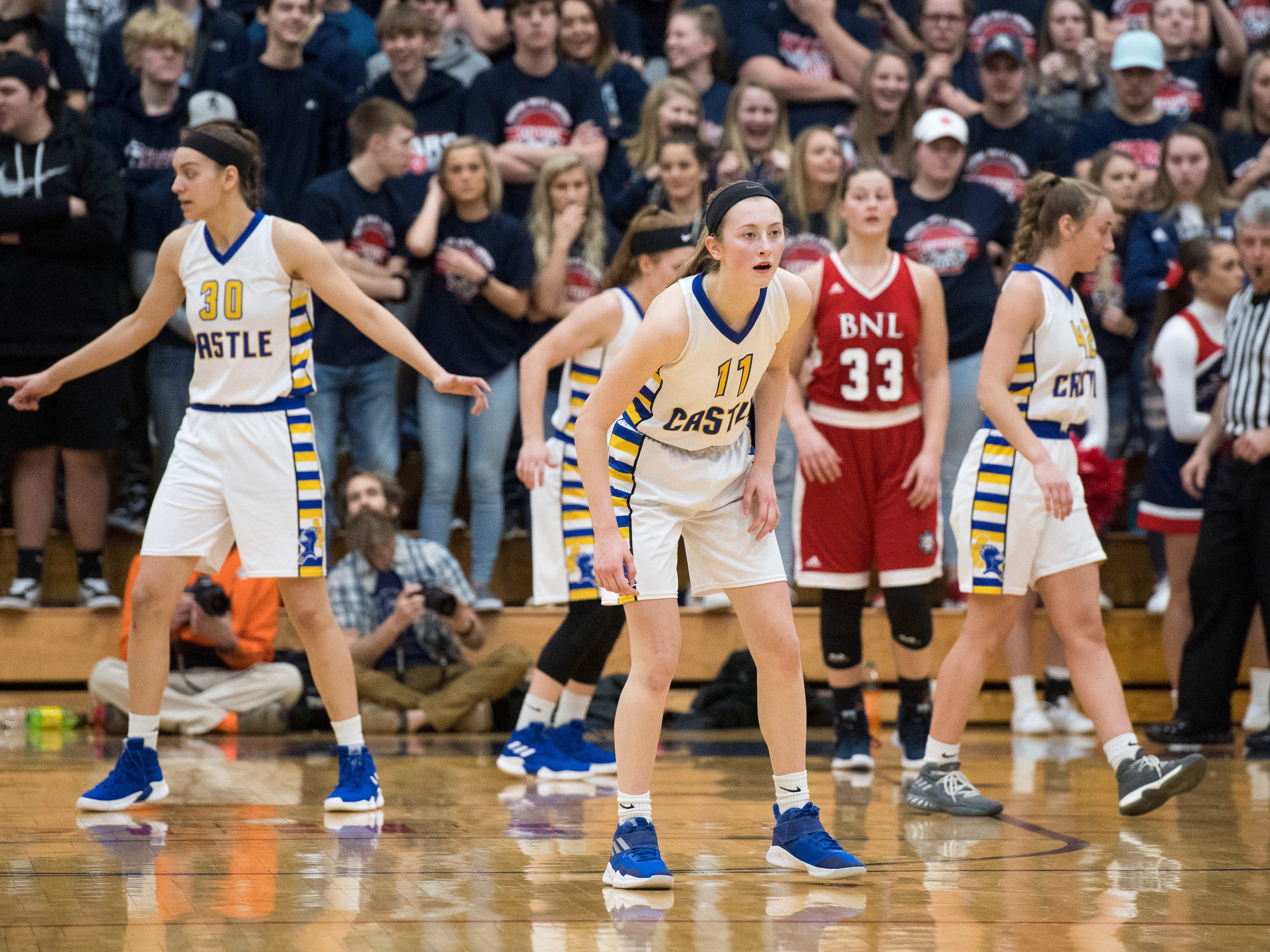 The Castle Knights defend during the IHSAA Girls Basketball Class 4A Regional Championship game against the Bedford North Lawrence Lady Stars at the Stars Field House in Bedford, Ind. Saturday, Feb. 9, 2019.