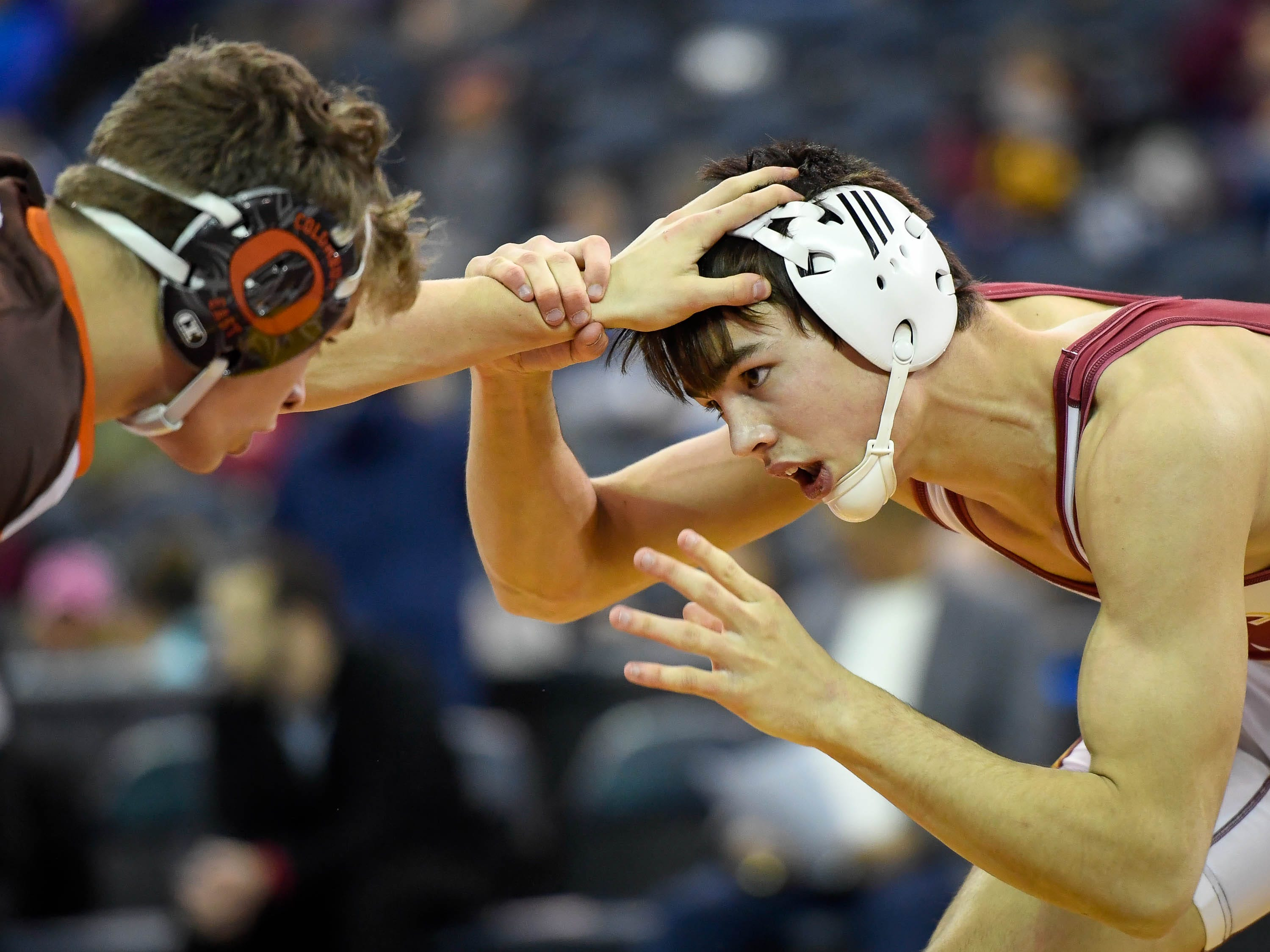 Mater Dei's Eli Dickens wrestles Jake Schoenegge, Columbus East in the 152 pound class at the finals of the Indiana High School Athletic Association Semi-State Wrestling Tournament held at the Ford Center Saturday, February 9, 2019.