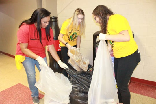 Mrs. Tallahassee Plus 2019 April Asker recycles with students.