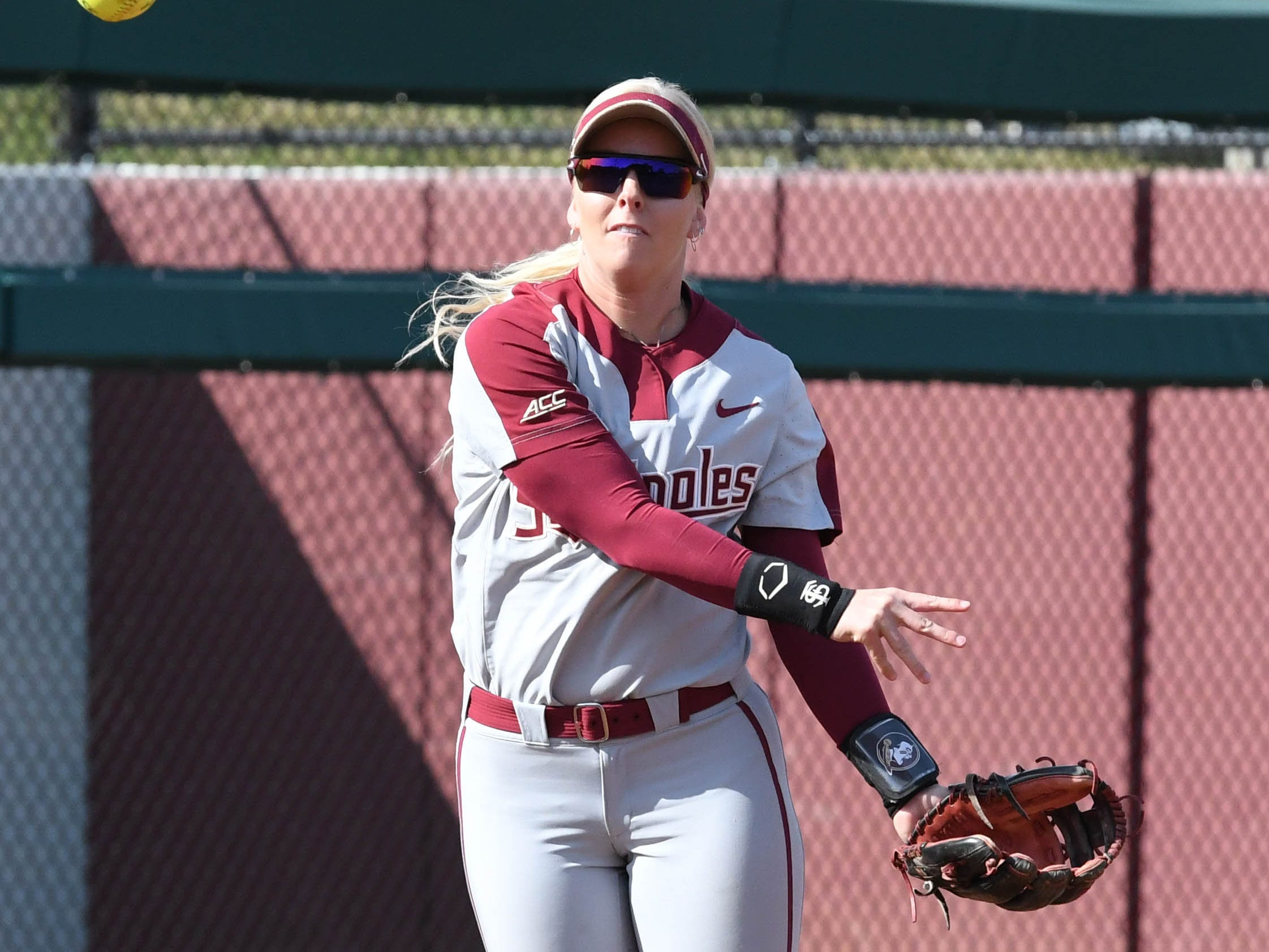 FSU sophomore infielder Sydney Sherril grounding the ball in the fourth inning of FSU's game against UNCG at Joanne Graf field on February 9, 2019.