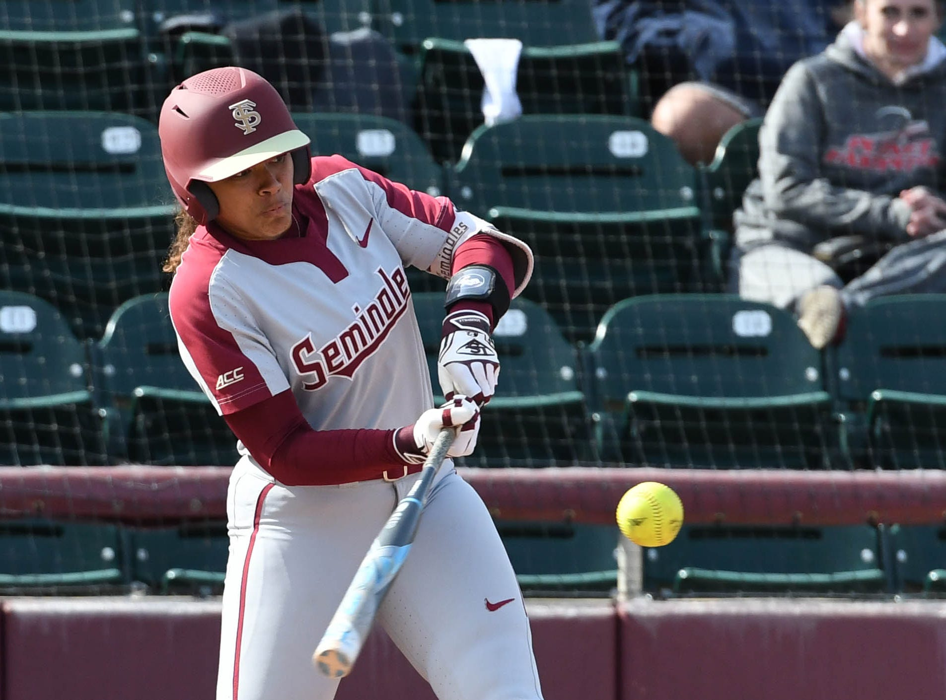 FSU redshirt sophomore utility Elizabeth Mason (5) hitting a basehit in the fourth inning of FSU's game against UNCG at Joanne Graf field on February 9, 2019.