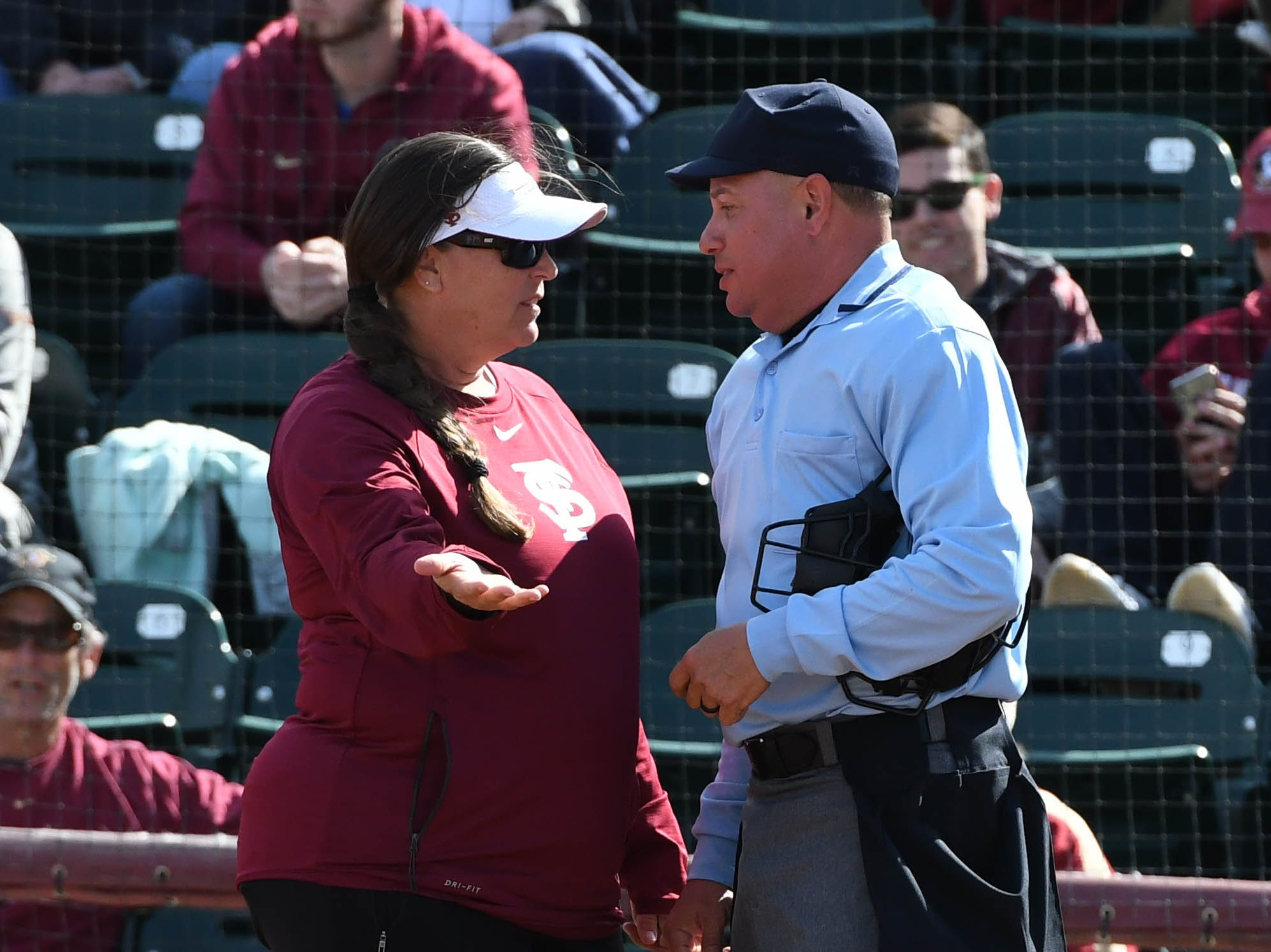 FSU head coach Lonni Alameda talking to the umpire in FSU's game against UNCG at Joanne Graf field on February 9, 2019.