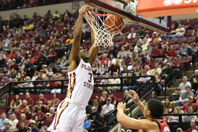 FSU junior guard Trent Forrest (3) dunking the basketball in the first half of FSU's game against Louisville at the Tucker Center on February 9, 2019.