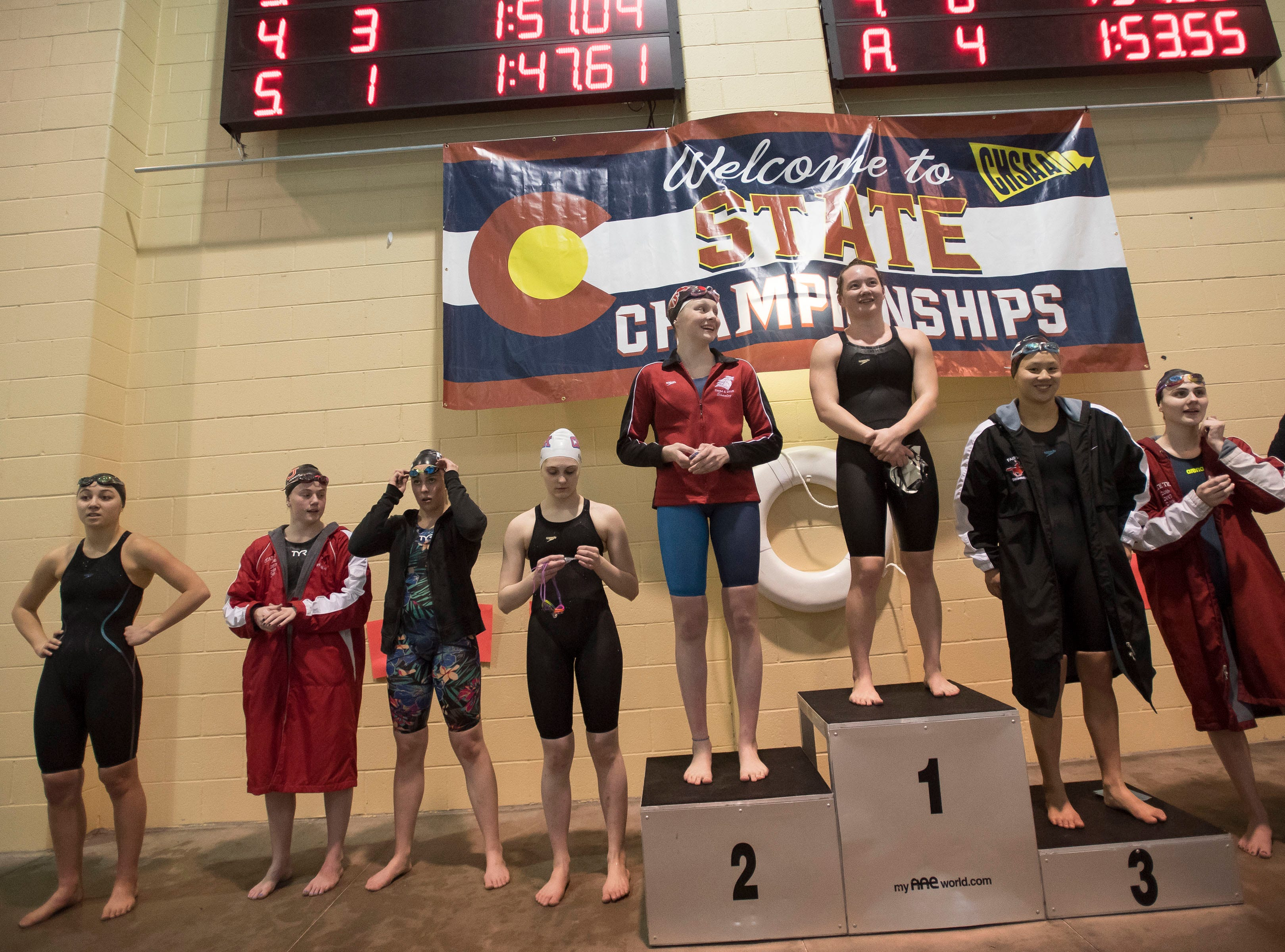 Fossil Ridge senior Coleen Gillilan stands atop the podium after winning the women's 200 yard freestyle on Saturday, Feb. 9, 2019, at Veterans Memorial Aquatic Center in Thornton, Colo.