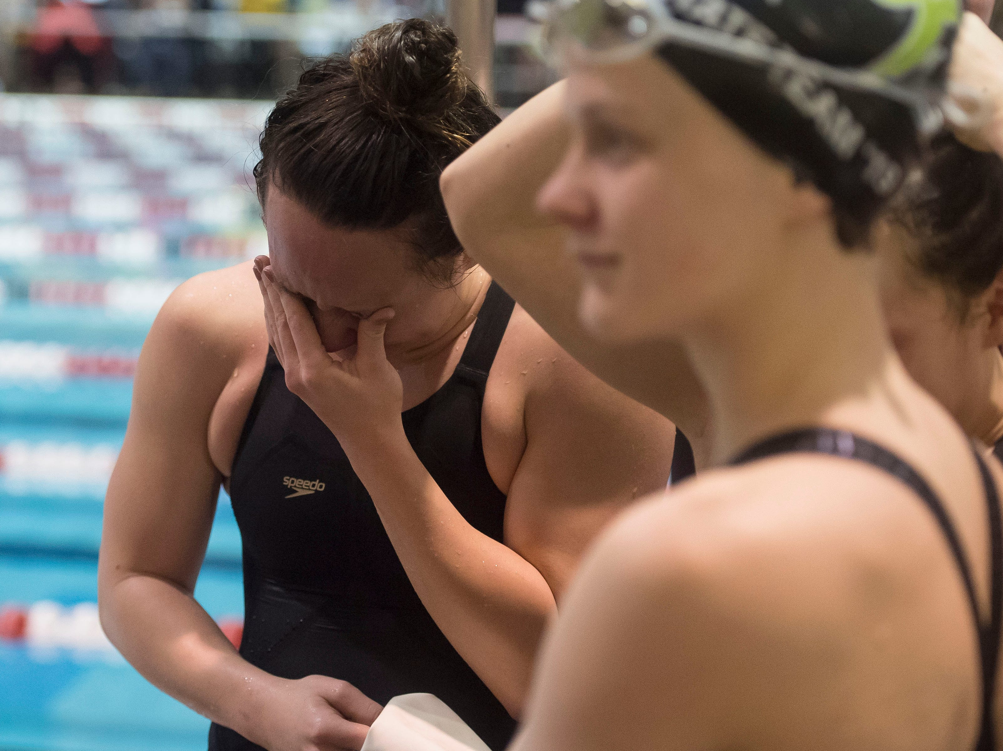 Fossil Ridge senior Coleen Gillilan fights back tears after helping to win the women's 400 yard freestyle relay on Saturday, Feb. 9, 2019, at Veterans Memorial Aquatic Center in Thornton, Colo.