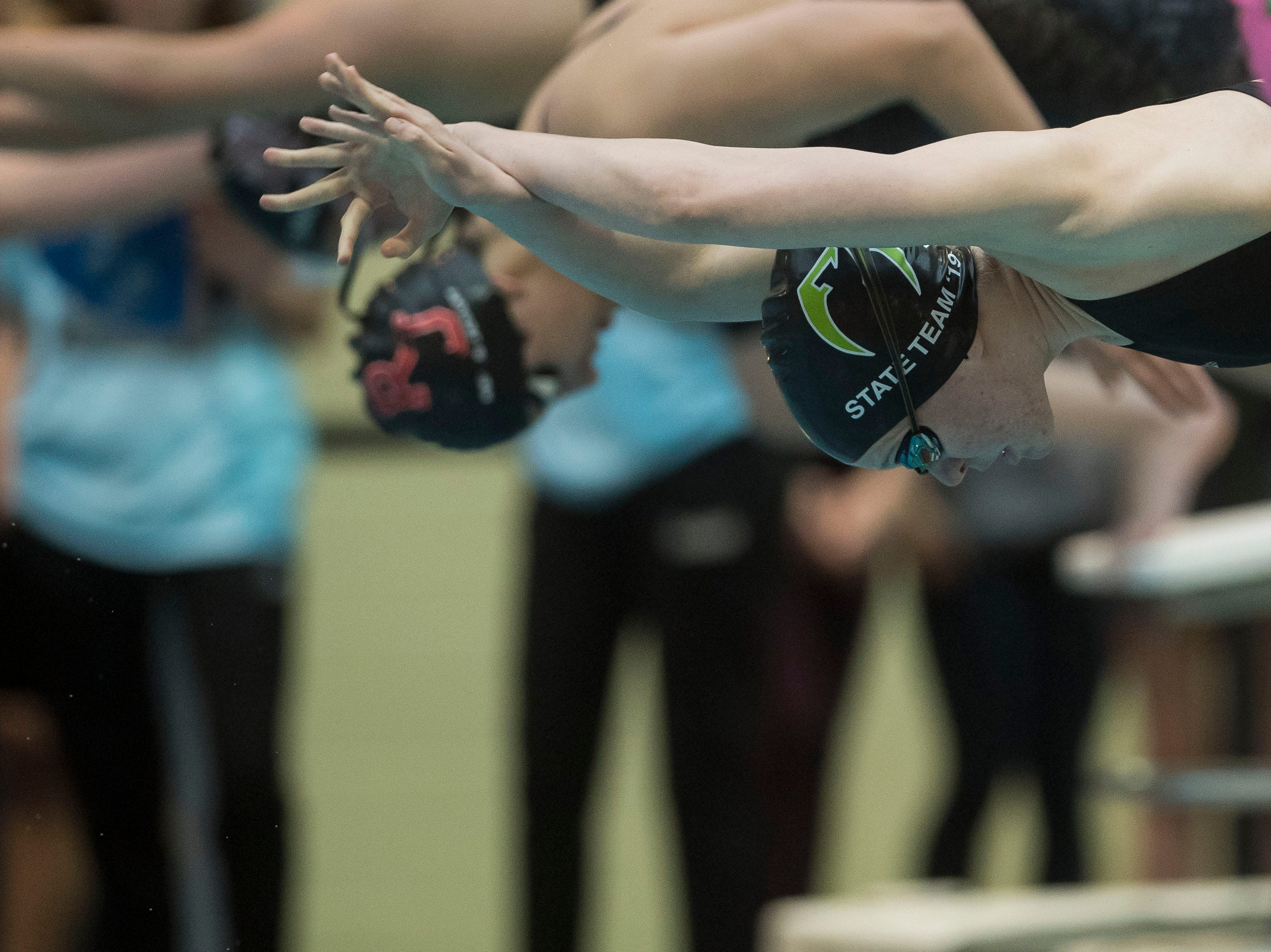 Fossil Ridge sophomore Emily Rinker dives off the blocks while competing in the women's 200 yard individual medley on Saturday, Feb. 9, 2019, at Veterans Memorial Aquatic Center in Thornton, Colo.