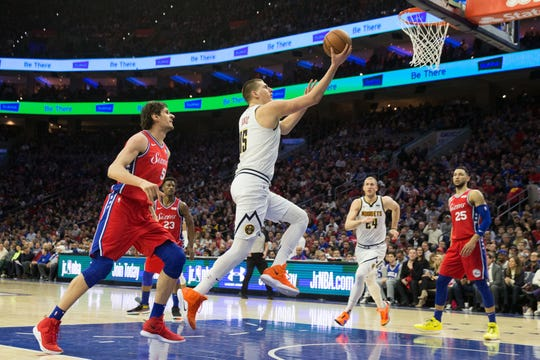 Center Nikola Jokic, shown driving for a layup against the Philadelphia 76ers in a road game Saturday, will play home games at 7 p.m. Monday against Miami and at 7 p.m. Wednesday vs. Sacramento.