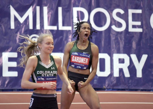 Colorado State runner MaryBeth Sant runs off the track as English Gardner celebrates her win Saturday in the women's 60-meter dash in the Millrose Games in New York. Sant finished fifth in the field of primarily professional runners.