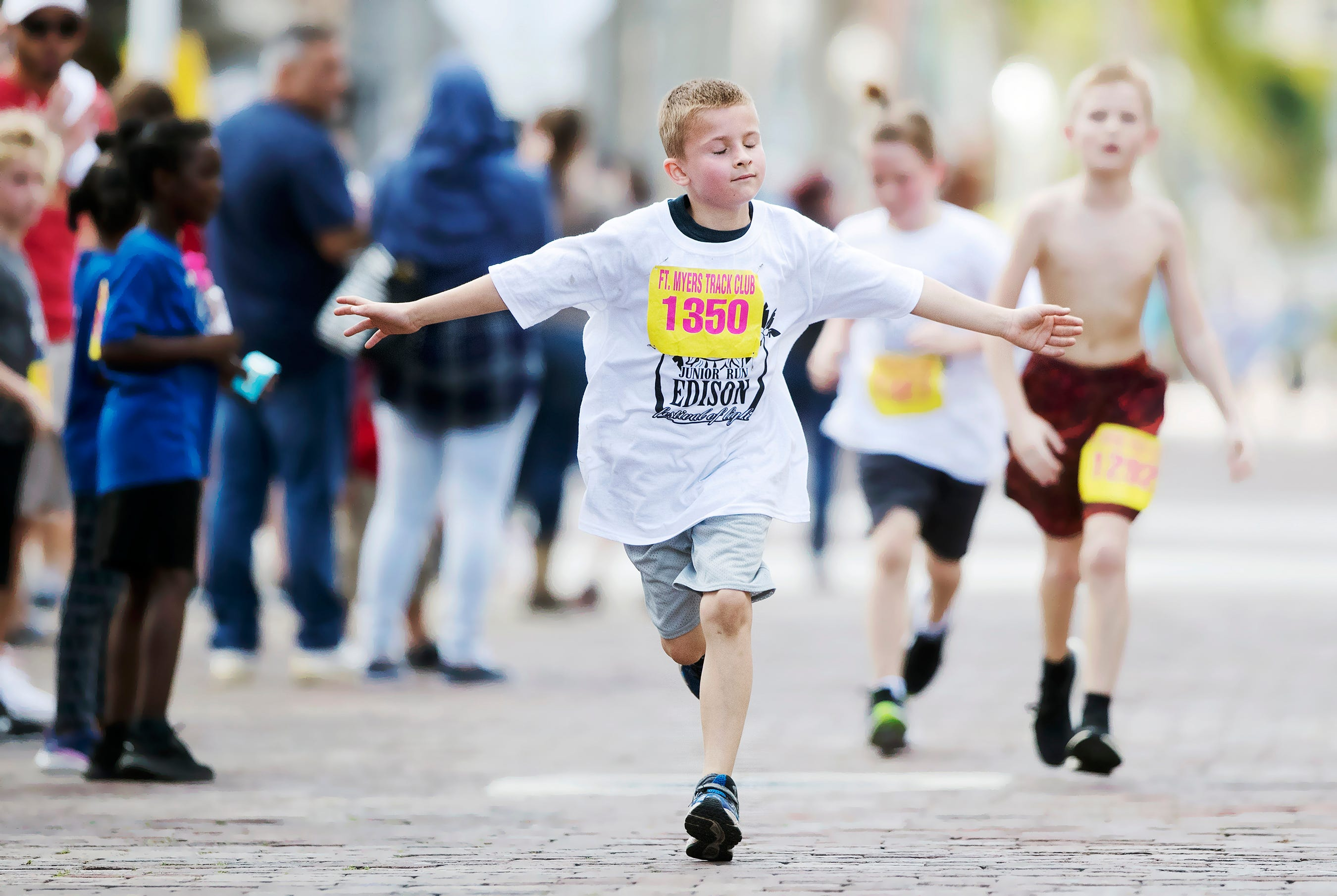 Logan Reeves, 8, was among more than 300 kids to run in the Edison Festival of Light Junior Fun Run races recently in downtown Fort Myers.