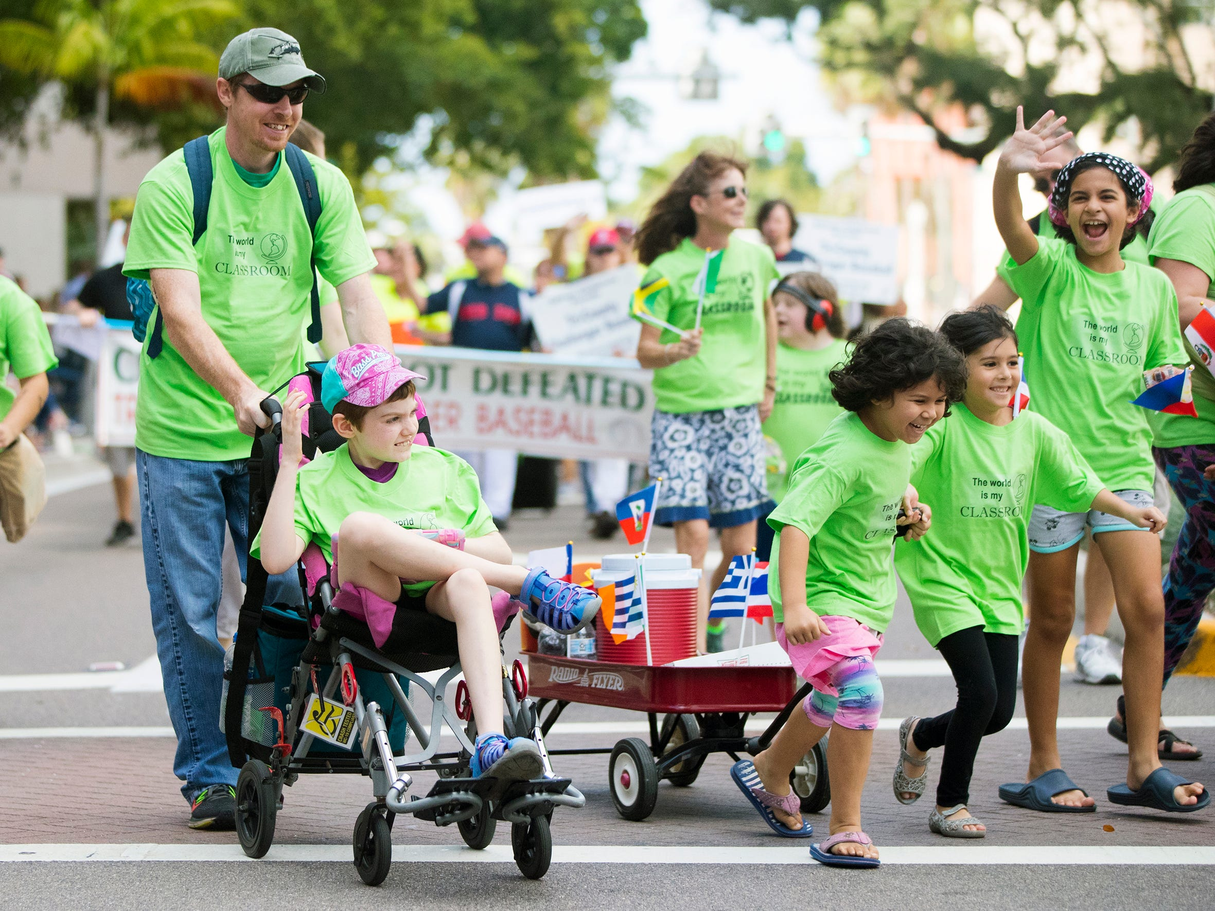 The Holistic Homeschoolers of SWFL march in the Edison Festival of Light Junior Parade on Sunday in downtown Fort Myers. More than 70 groups participated in the annual event.