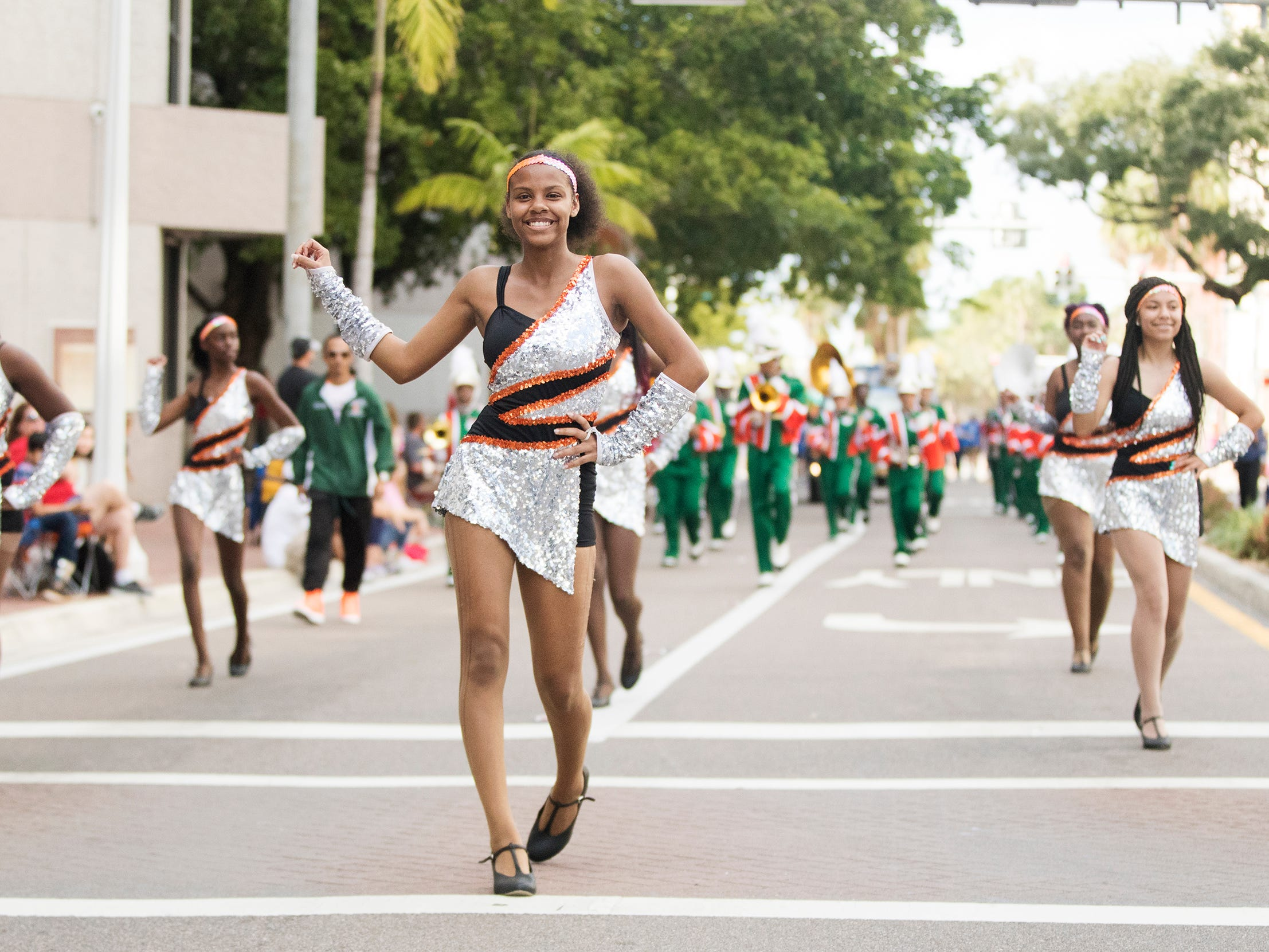 The Dunbar High School band marches in the Edison Festival of Light Junior Parade on Sunday in downtown Fort Myers. More than 70 groups participated in the annual event.