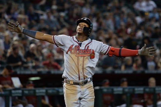 Atlanta Braves left fielder Ronald Acuna Jr. (13) celebrates after hitting a two-run home run against the Arizona Diamondbacks during the sixth inning at Chase Field.
