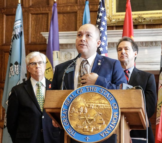 Rep. Casey Schreiner, D-Great Falls,  center, is carrying the bill that would fund public preschool, special education. He presented the bill at a Feb. 3 news conference with Gov. Steve Bullock, right, and Lt. Gov. Mike Cooney.