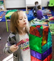 Alberton preschooler Lillie Baughman, 4, inspects the structure she built during playtime on Feb. 6.