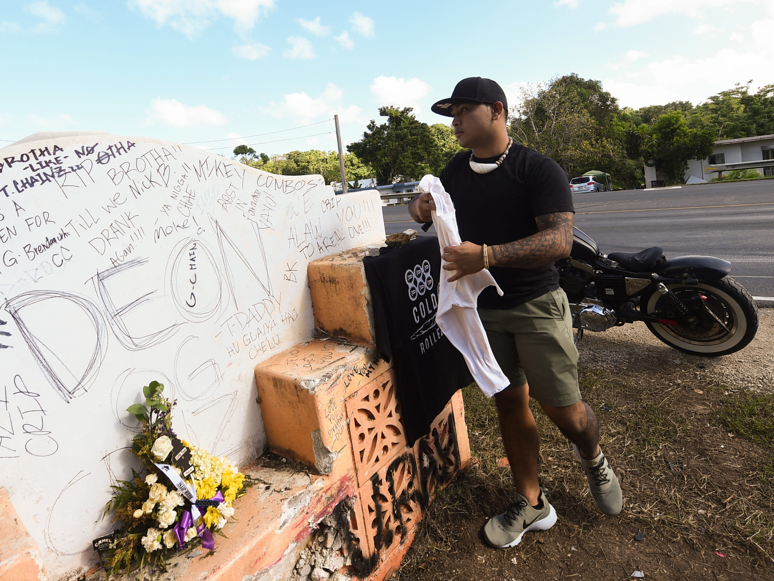Taga Santos aproaches the concrete sign located at the fatal Ordot crash site of his best friend, Deon Cruz, 19, on Feb. 10, 2019.