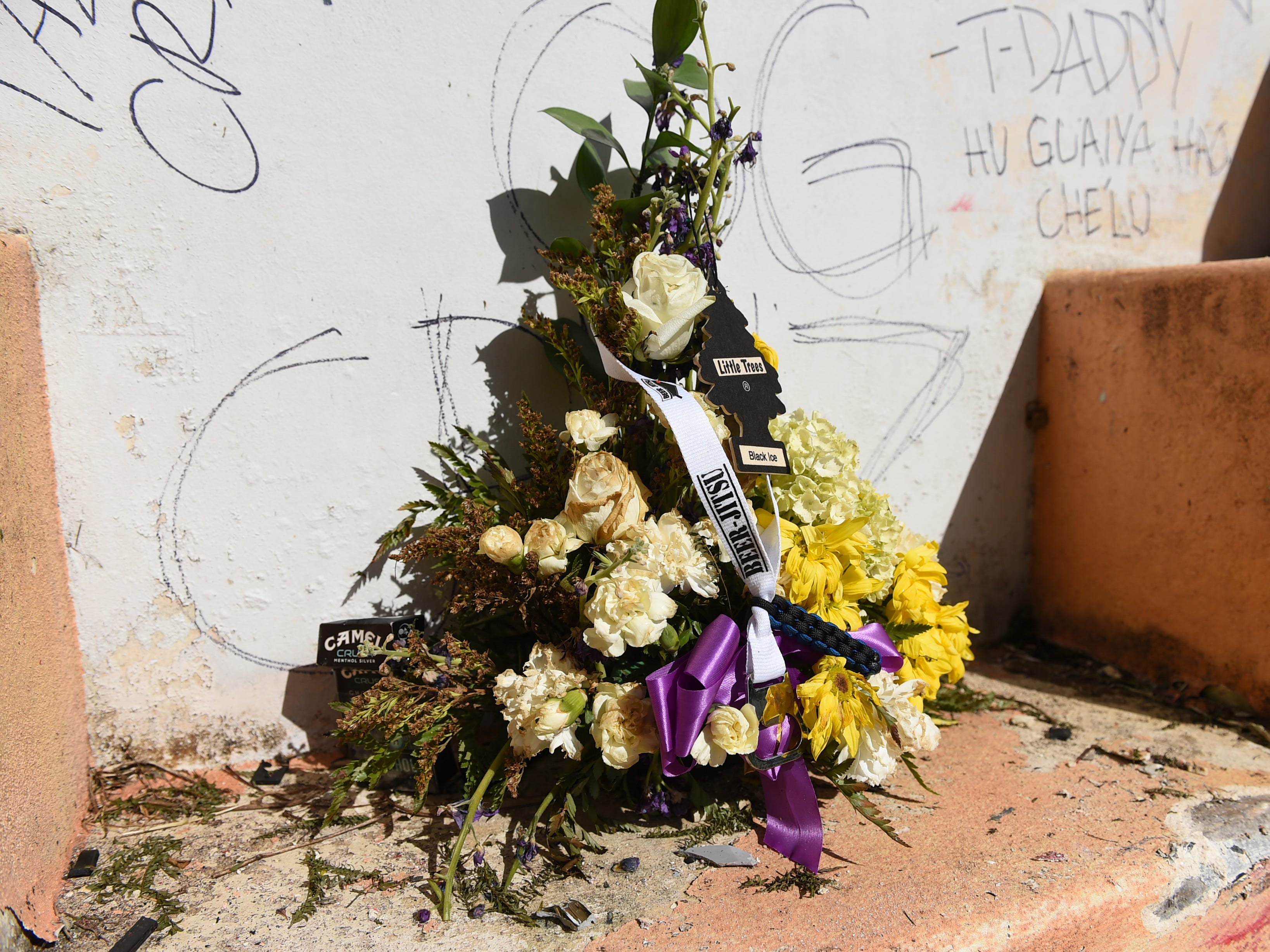 A decorated floral arrangement at the fatal crash site of Deon Cruz, 19, in Ordot on Feb. 10, 2019.