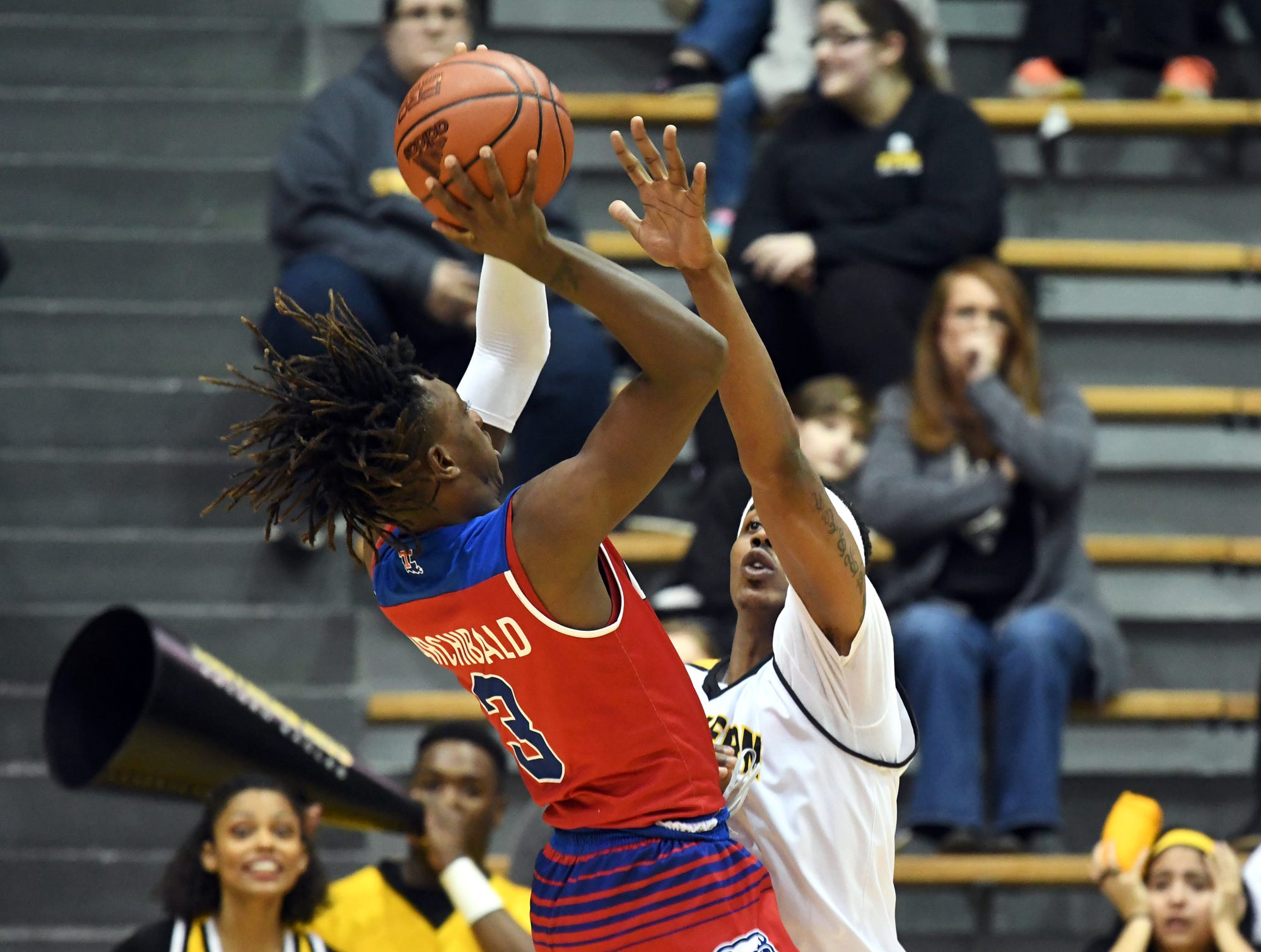 Southern Miss forward Leonard Harper-Baker attempts to block a pass in a game against Louisiana Tech in Reed Green Coliseum on Saturday, February 9, 2019.