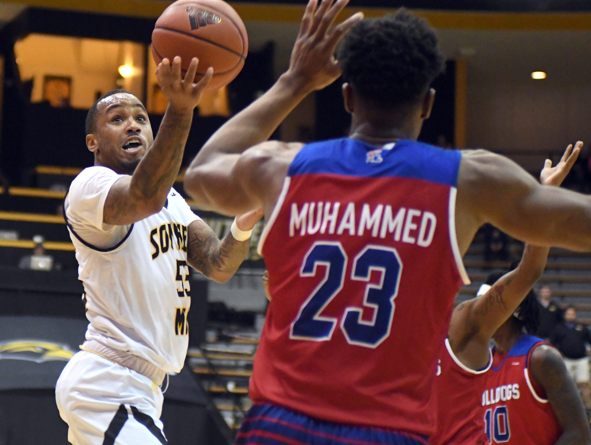 Southern Miss guard Tyree Griffin shoots over a defender in a game against Louisiana Tech in Reed Green Coliseum on Saturday, February 9, 2019.