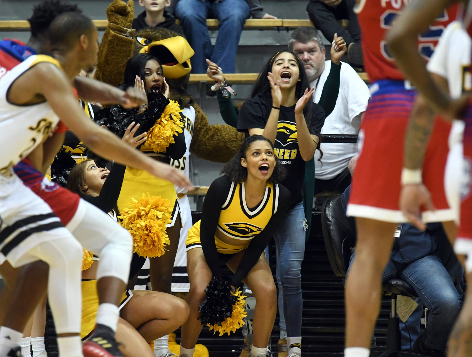 Southern Miss cheerleaders distract a Louisiana Tech player during a free throw in Reed Green Coliseum on Saturday, February 9, 2019.