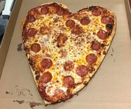 Get your heart-shaped pizza from Rockhouse on the River.