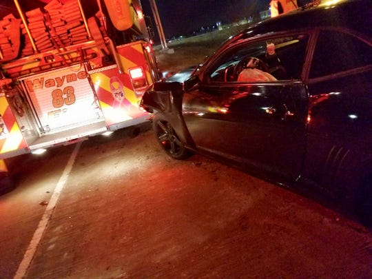 A man was arrested after crashing his car into a fire truck.