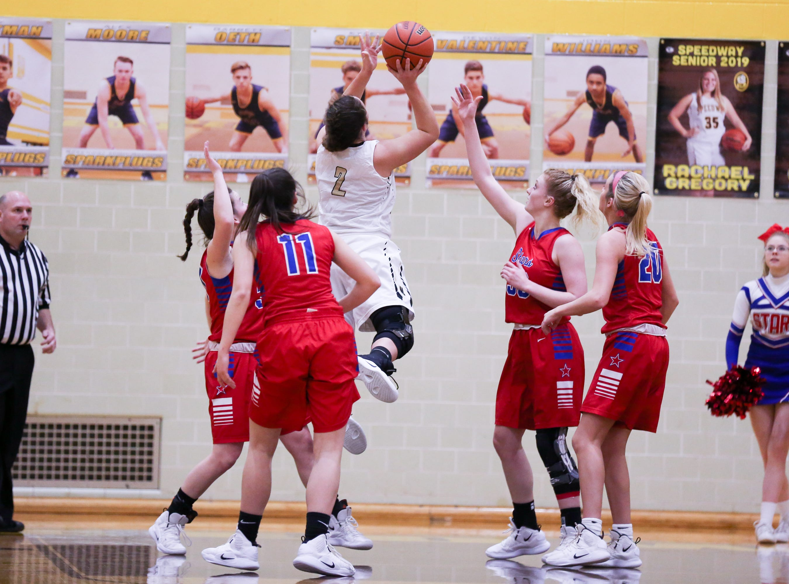 Winchester Community Madeline Lawrence (2) finds an opening for a short jump shot during the first half of Western Boone vs. Winchester Community high school girls varsity 2A Regional basketball tournament held at Speedway High School, February 9, 2019.