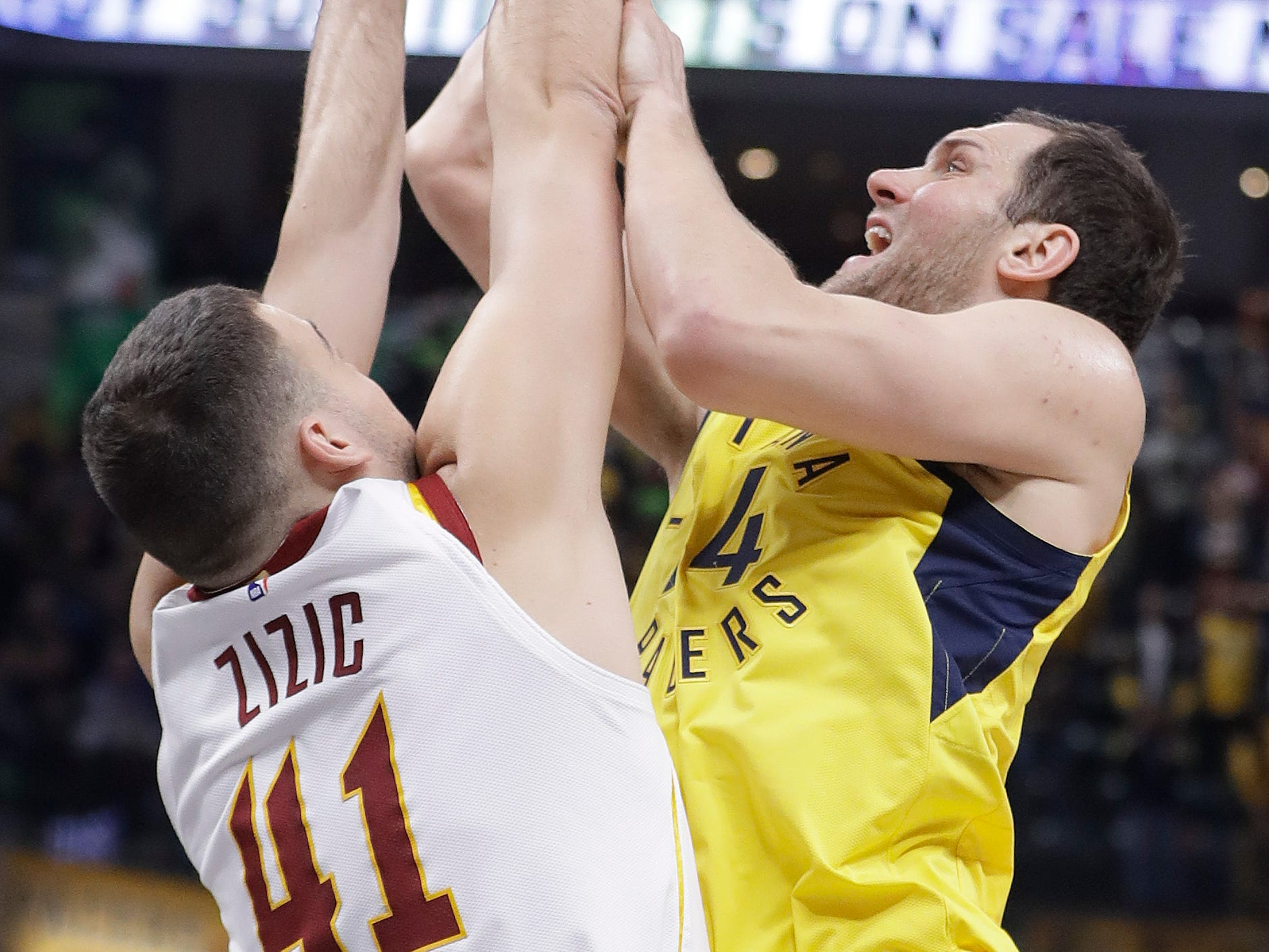 Indiana Pacers' Bojan Bogdanovic shoots over Cleveland Cavaliers' Ante Zizic during the first half.