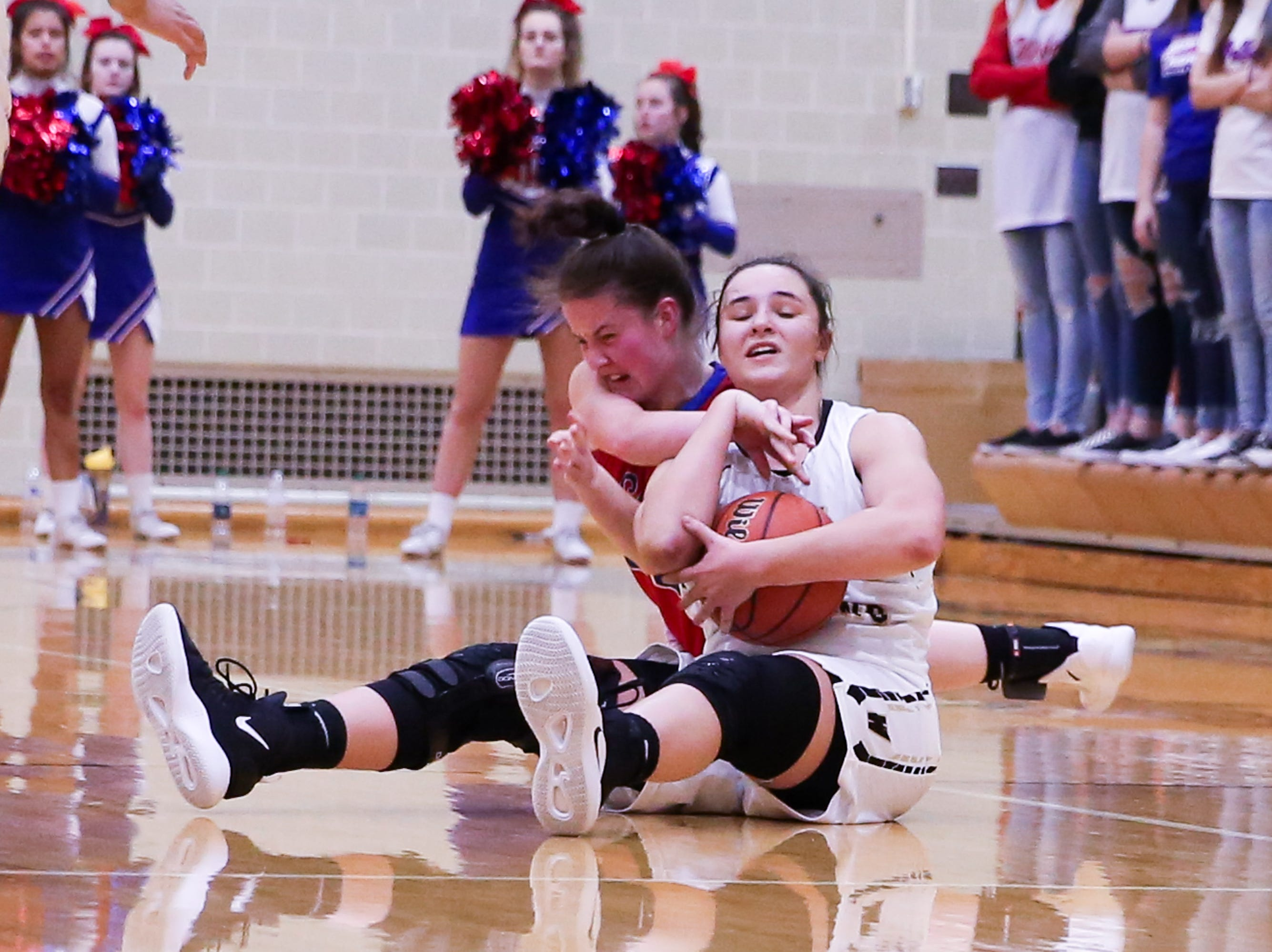 Winchester Community Madeline Lawrence (2) fights to hold on to a loose ball during the second half of Western Boone vs. Winchester Community high school girls varsity 2A Regional basketball tournament held at Speedway High School, February 9, 2019.