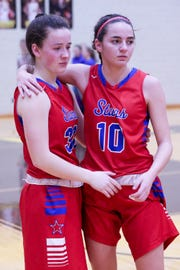 Western Boone Emily Voils (10)  comforts Western Boone Hillary Reed (30) after their loss at the Western Boone vs. Winchester Community high school girls varsity 2A Regional basketball tournament held at Speedway High School, February 9, 2019.