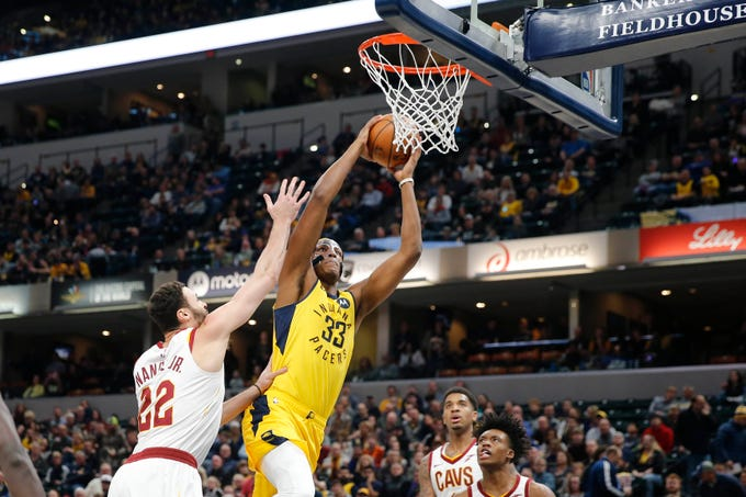 Indiana Pacers center Myles Turner (33) dunks against Cleveland Cavaliers forward Larry Nance Jr. (22) during the first quarter at Bankers Life Fieldhouse.