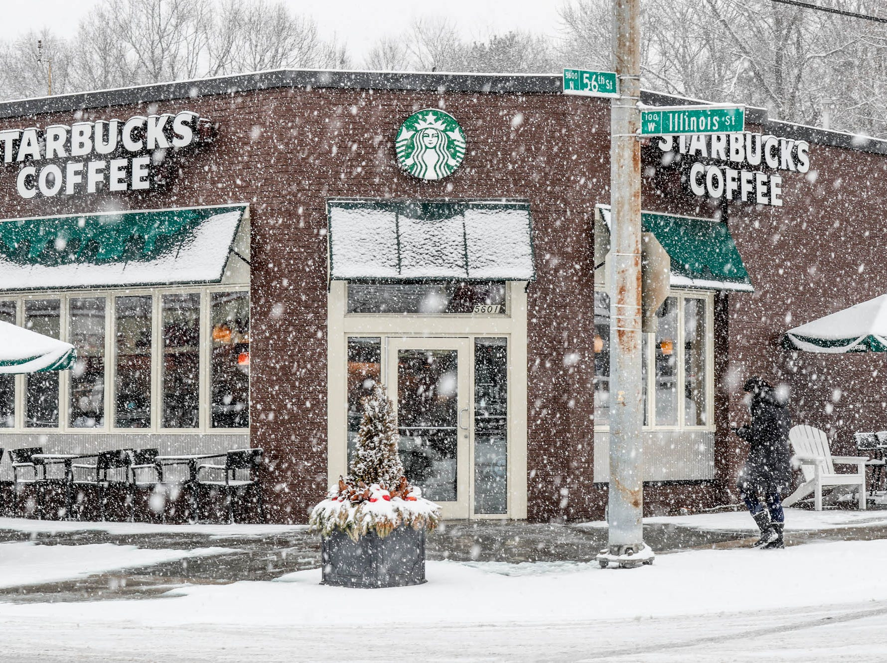 Snow falls at 65th and Illinois St. in Indianapolis on Sunday, Feb. 10, 2019.