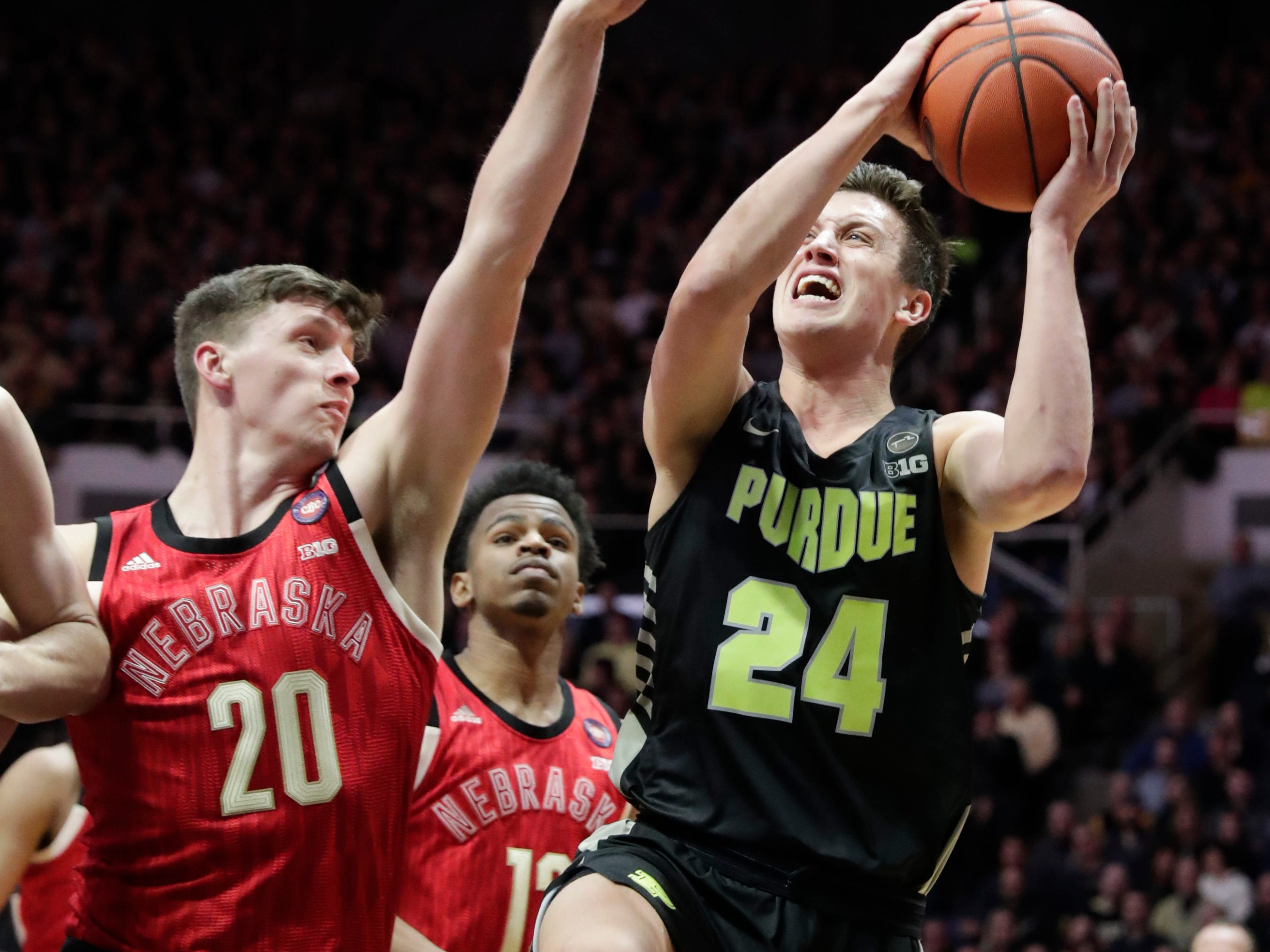 Purdue forward Grady Eifert (24) shoots over Nebraska forward Tanner Borchardt (20) during the first half