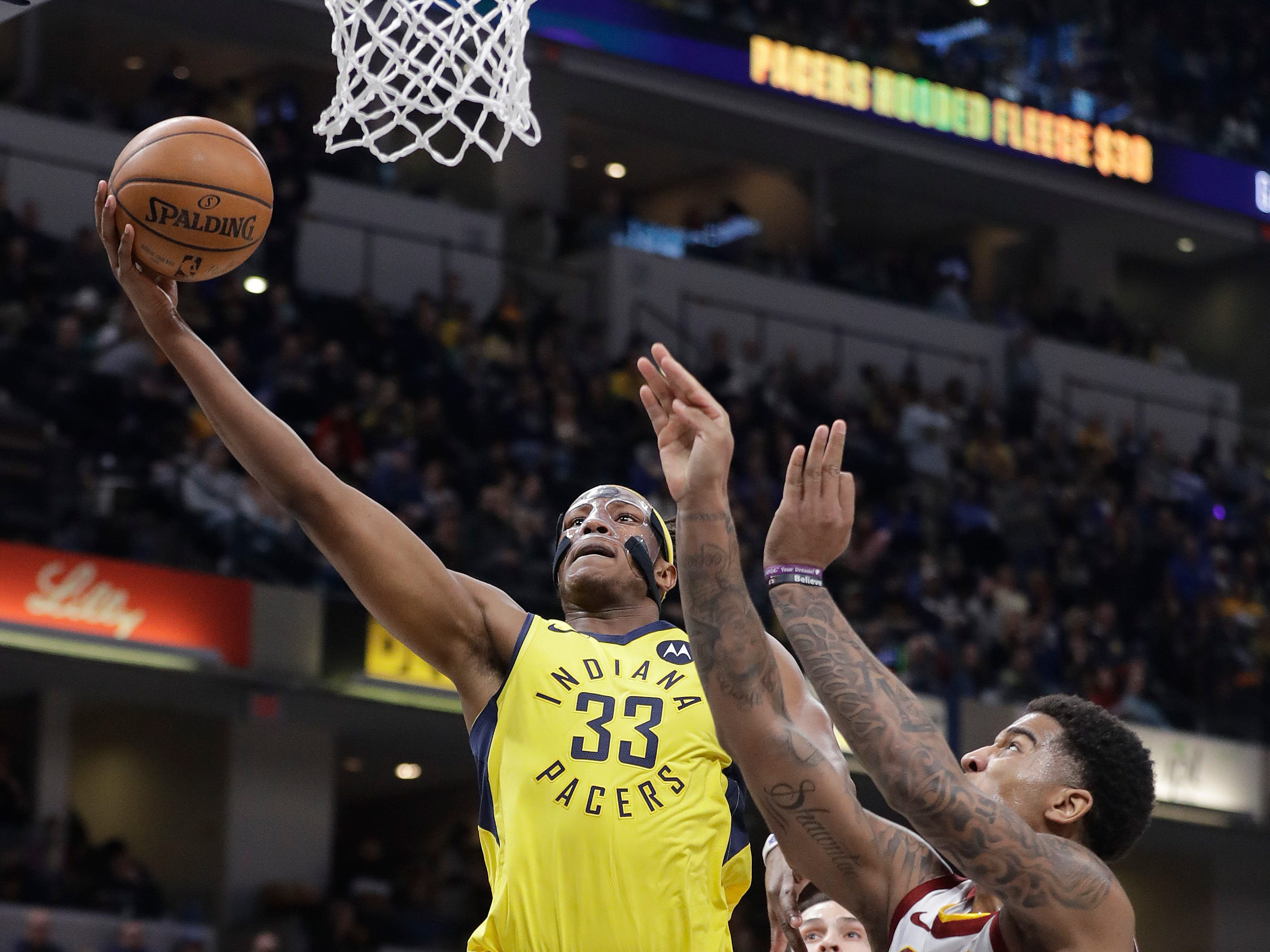 Indiana Pacers' Myles Turner goes up to shoot against Cleveland Cavaliers' Marquese Chriss during the first half.