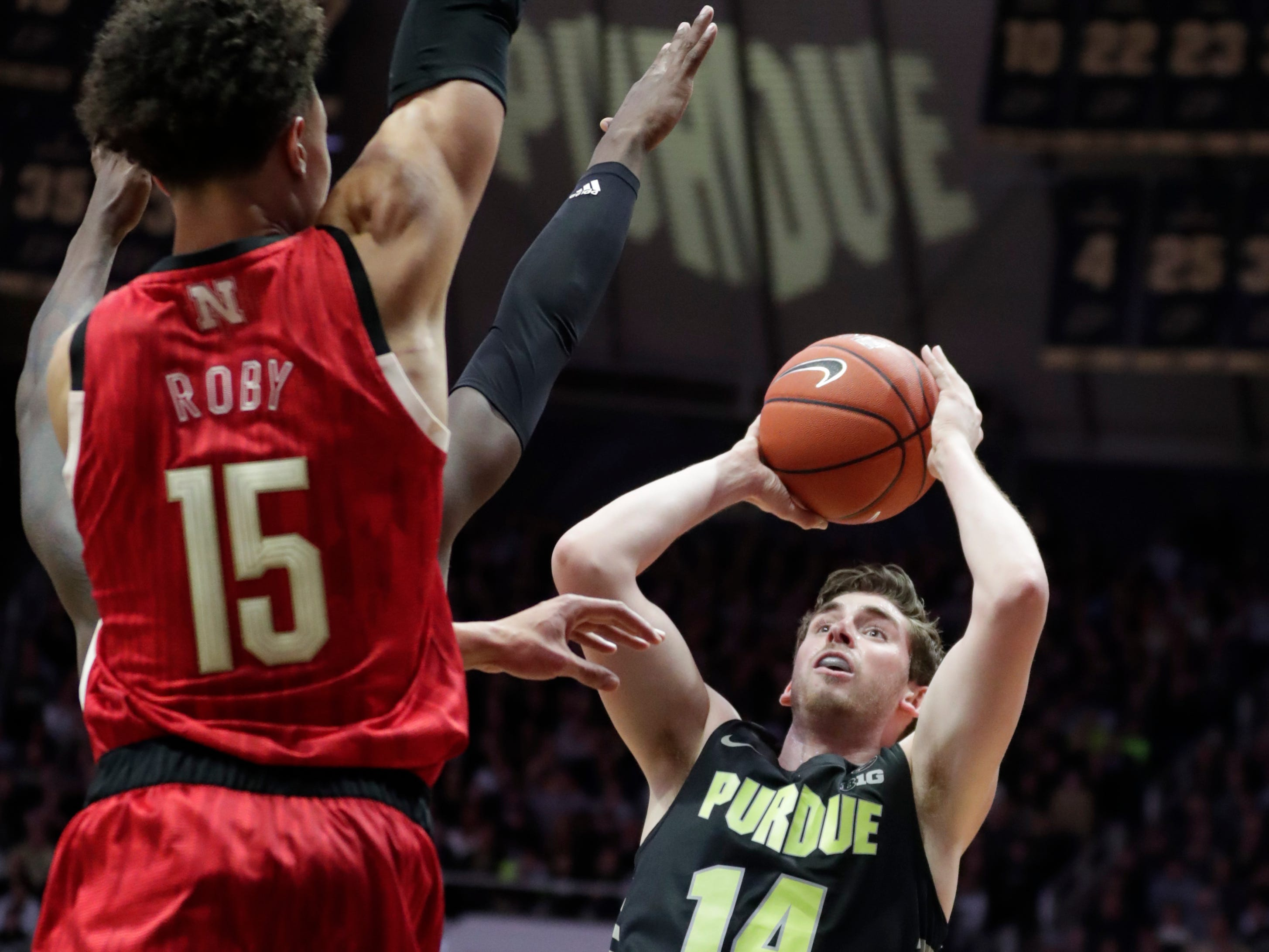 Purdue guard Ryan Cline (14) shoots over Nebraska forward Isaiah Roby (15) during the first half.